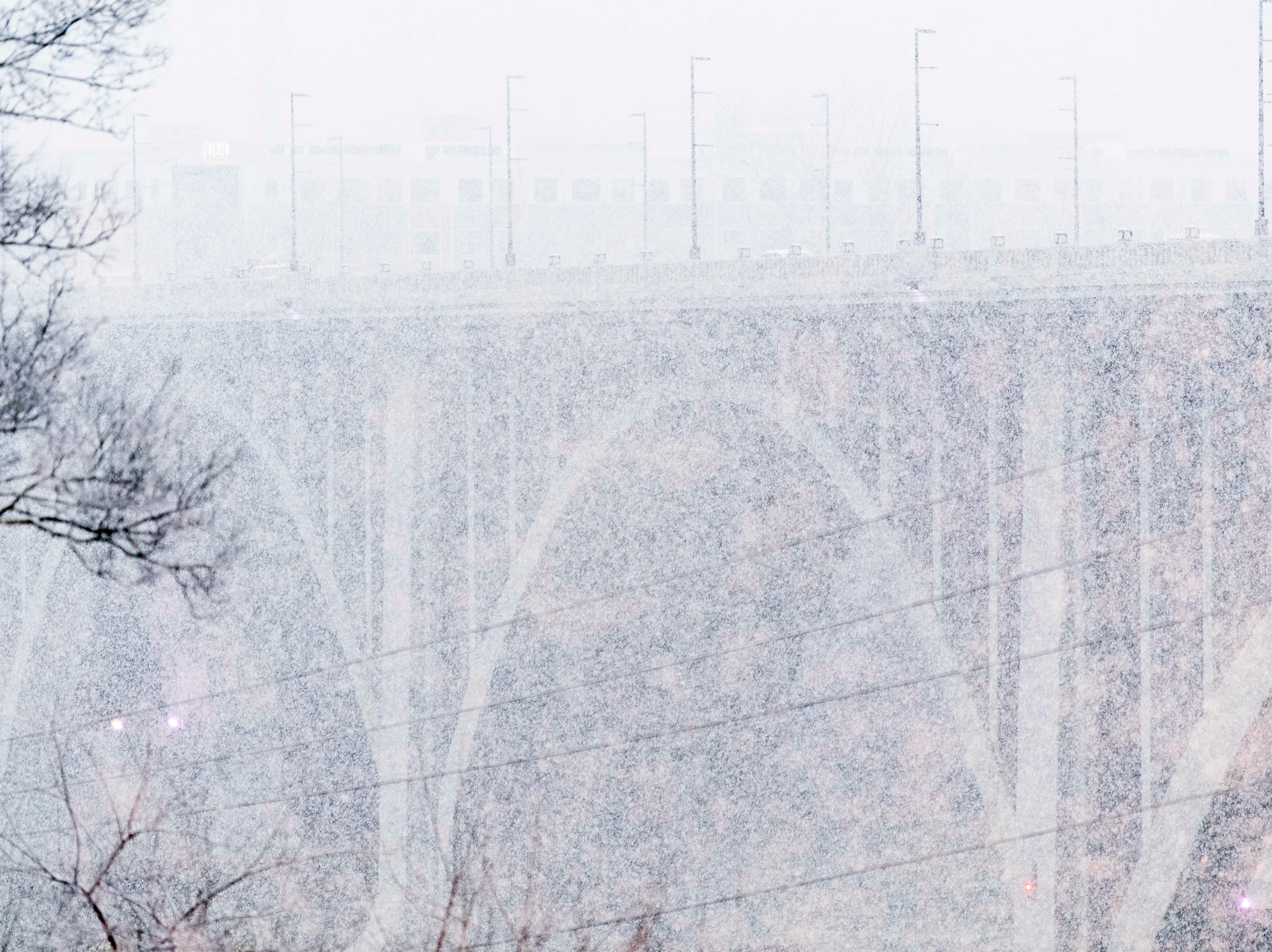 The Henley Street Bridge is barely visible through dense snowfall in Knoxville, Tennessee on Tuesday, January 29, 2019.