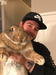 Connor Corcoran holds Barley the giant rabbit.