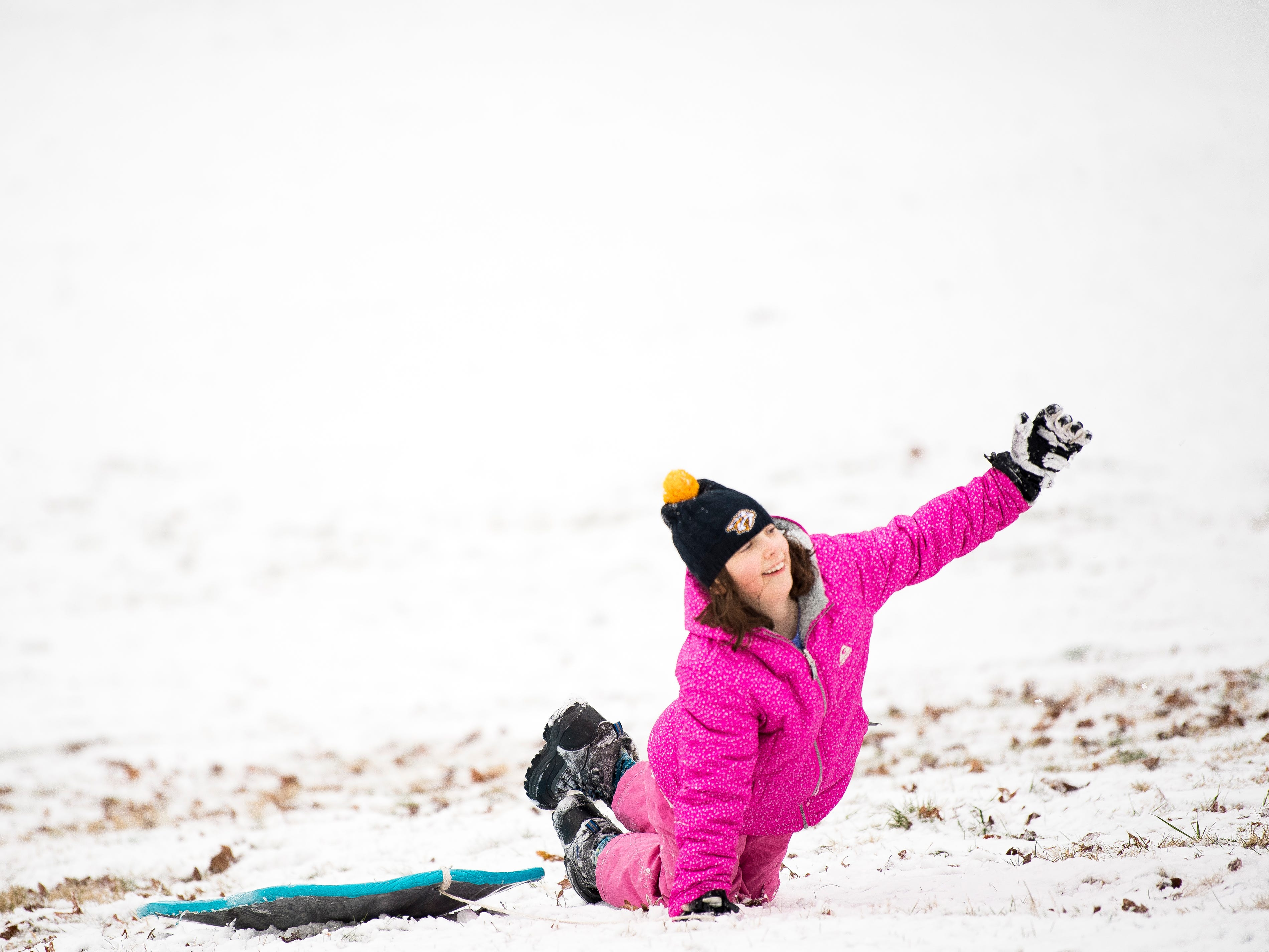 Ainsley Patterson struggles climbing back up a steep hill with her sled at Lakeshore Park in Knoxville on Tuesday, January 29, 2019.