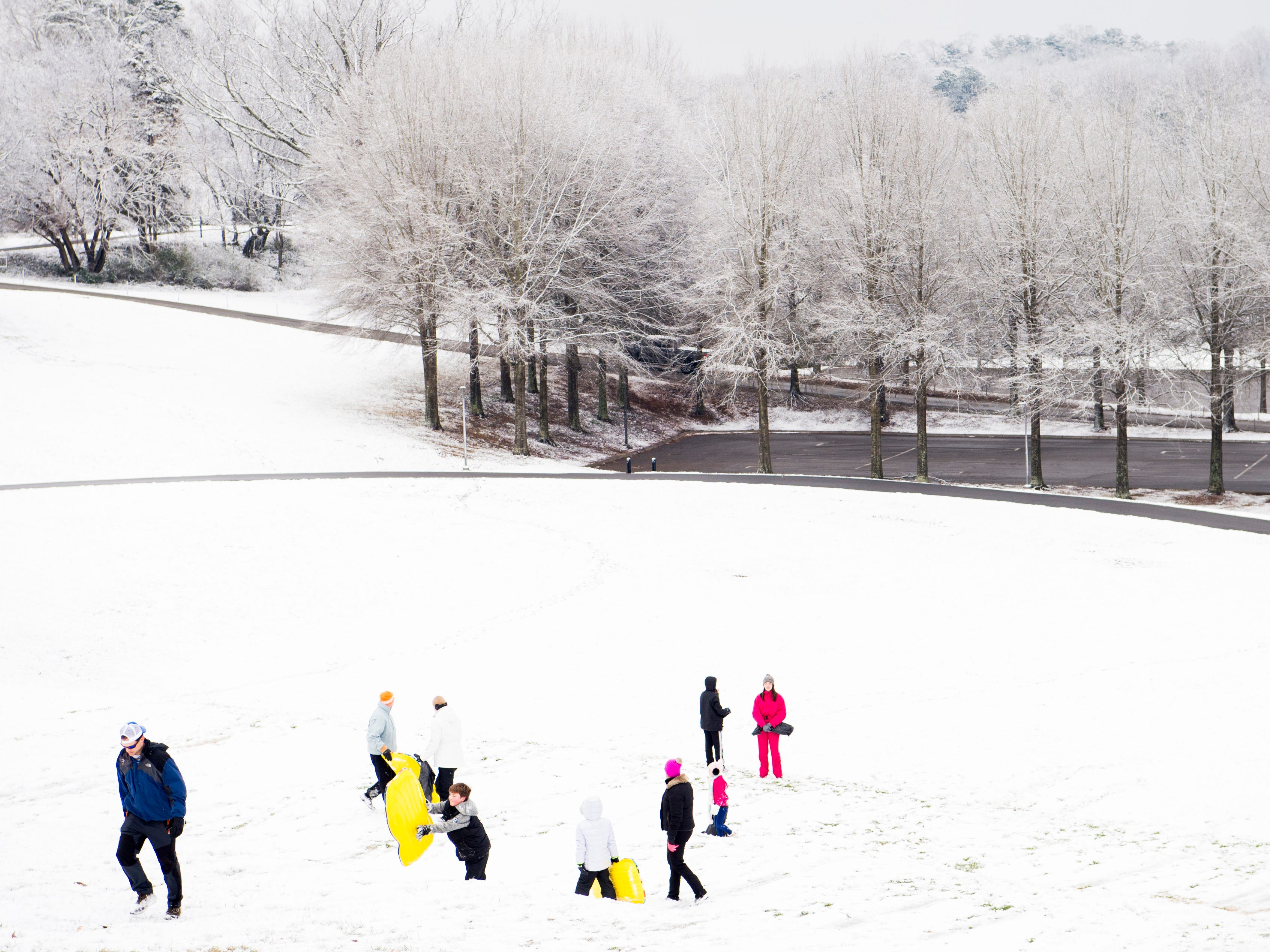 Families sled at Lakeshore Park in Knoxville on Tuesday, January 29, 2019.