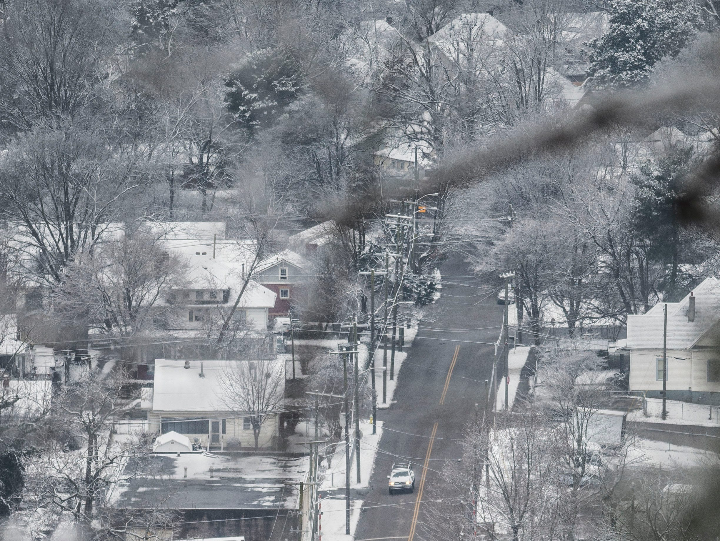 Vehicles drive down Pershing Street in the Oakwood-Lincoln Park neighborhood, as seen from Sharps Ridge in North Knoxville Tuesday, Jan 29, 2019. The Knoxville area received about an inch of snow.