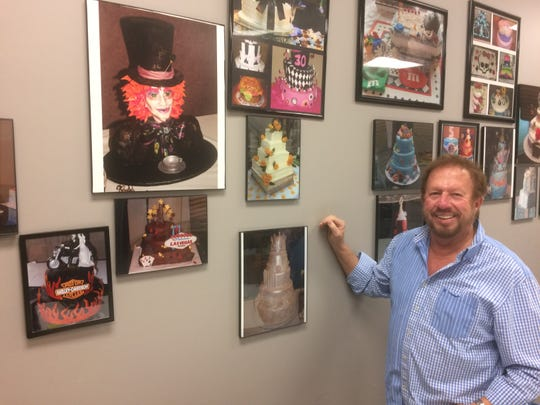 Larry Clark is proud of his wall of fame, featuring photos of great cakes baked by his customers.