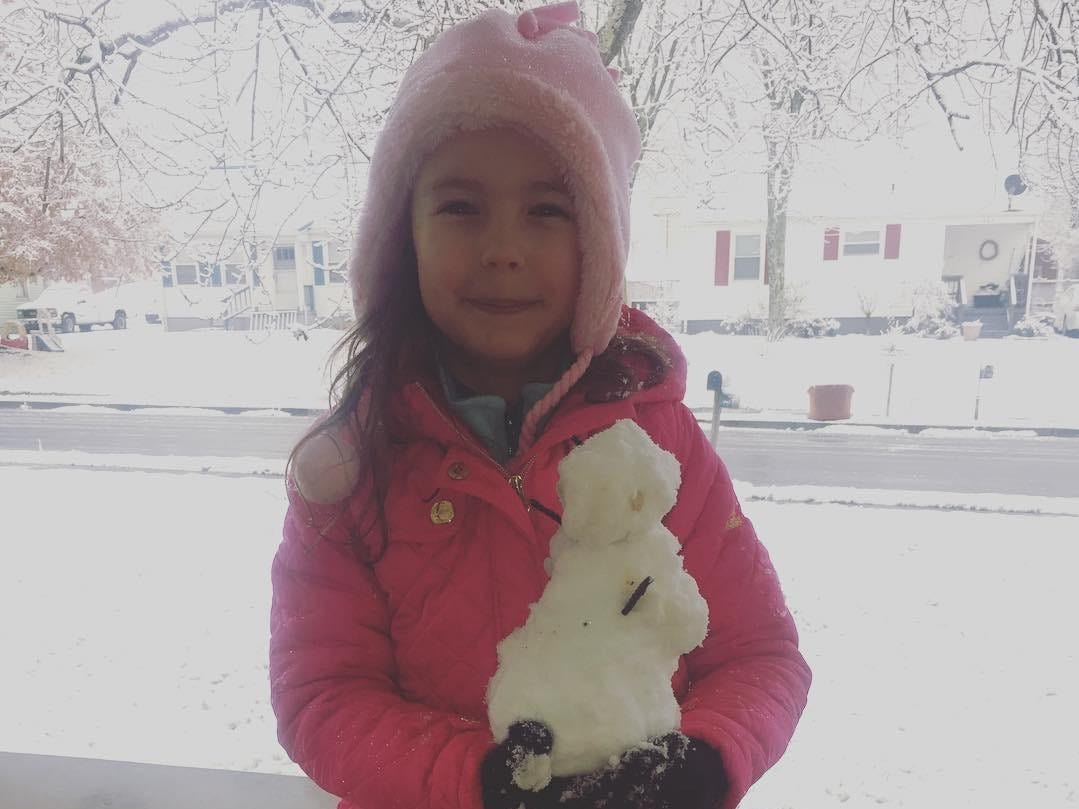 Hadley Kyte, 6, in Blount County is proud of her snowman on Tuesday, Jan. 29, 2019.