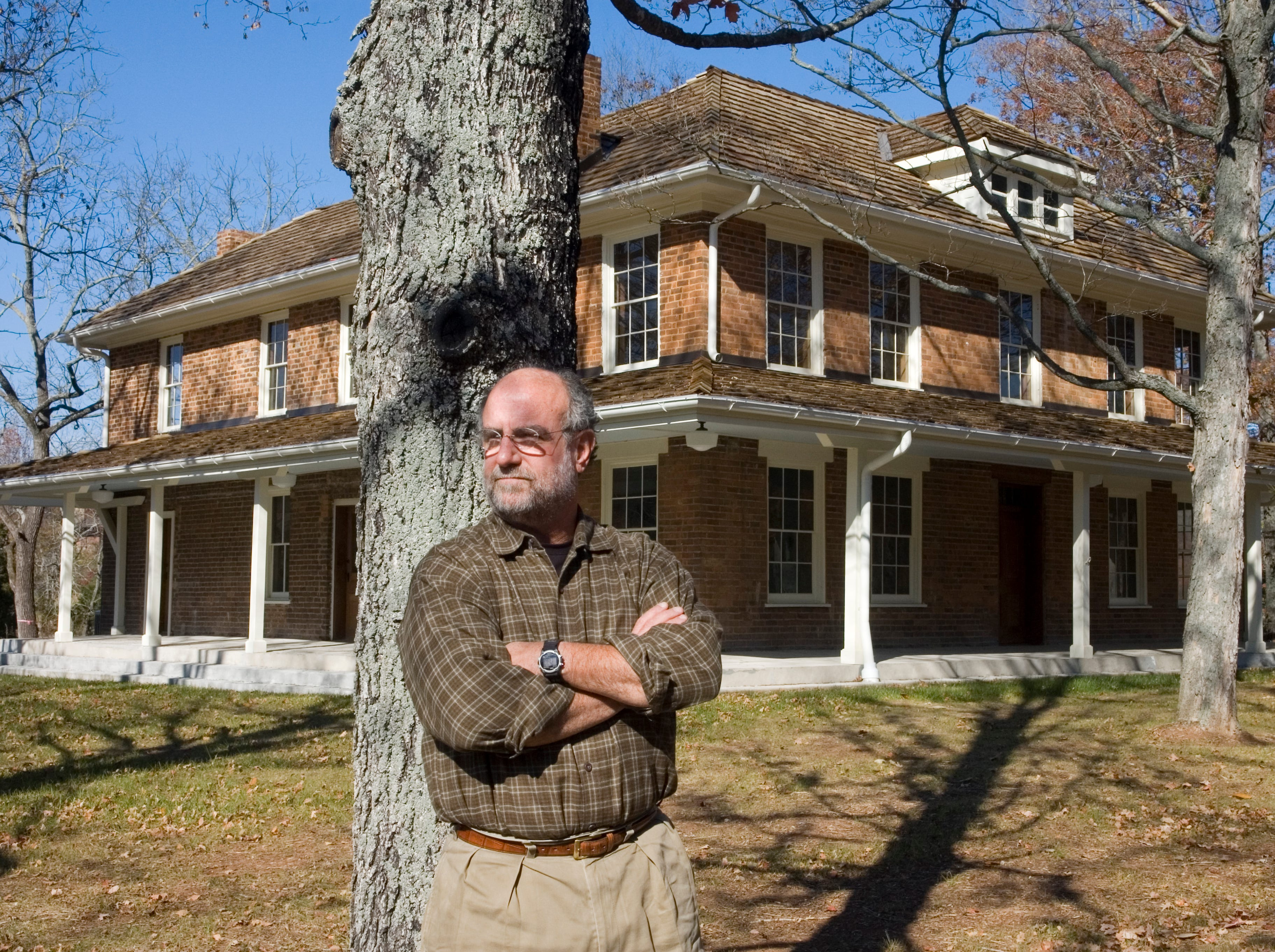 """Tom Weiss pauses in front of the Lones-Dowell house, 6341 Middlebrook Pike, on Monday, November 10, 2008. Weiss was honored as one of the """"Fantastic Fifteen"""" at the Knox heritage Annual Meeting and Preservation Awards November 5, 2008."""
