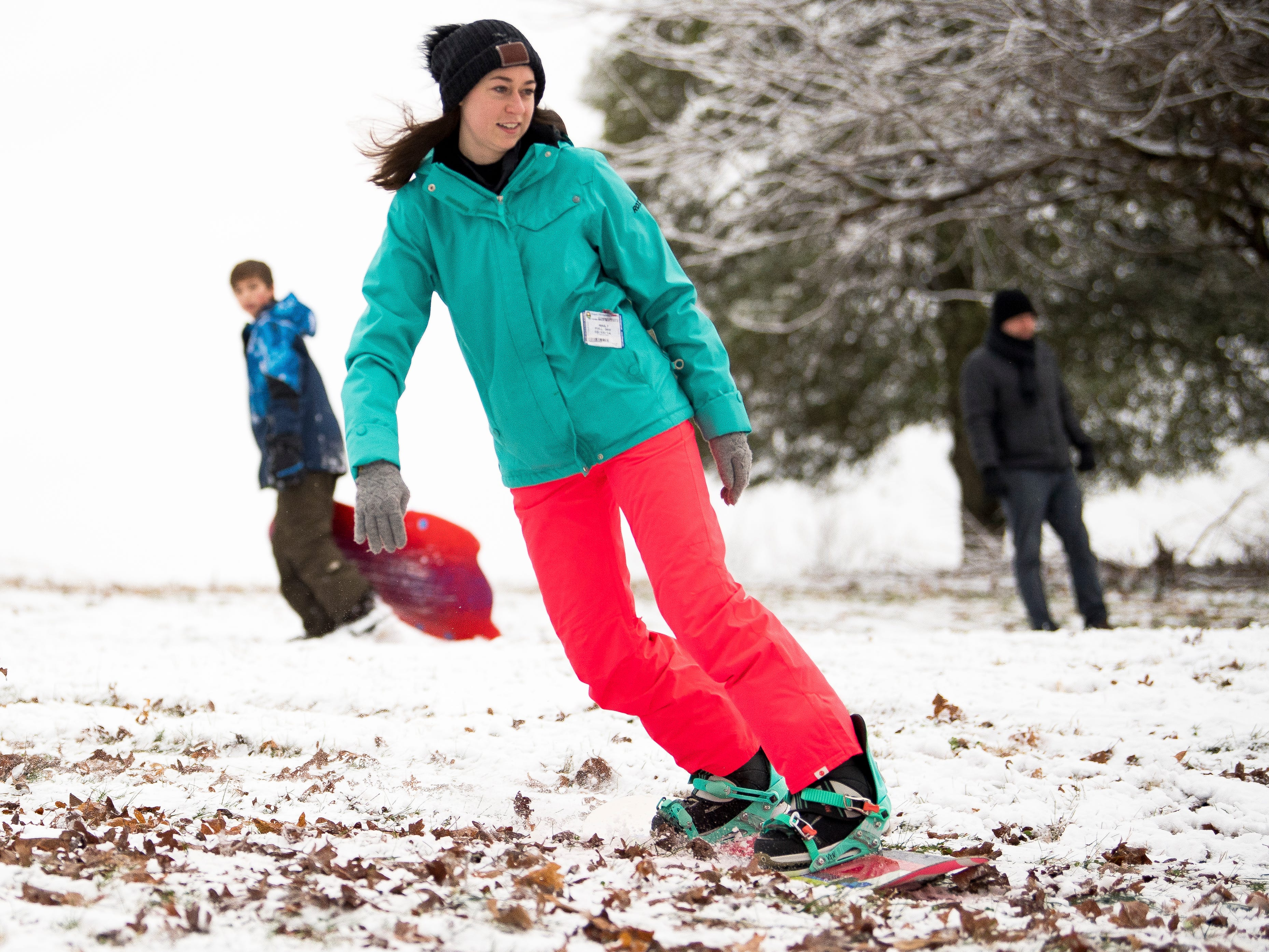 Mary Alice Cox snowboards down a steep hill at Lakeshore Park in Knoxville on Tuesday, January 29, 2019.