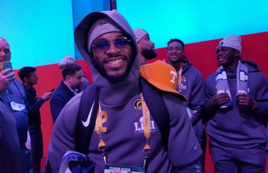 Former Vols RB and current Rams back John Kelly displays a Tennessee Volunteers hat on his shoulder during Super Bowl Opening Night on Jan. 28 in Atlanta.