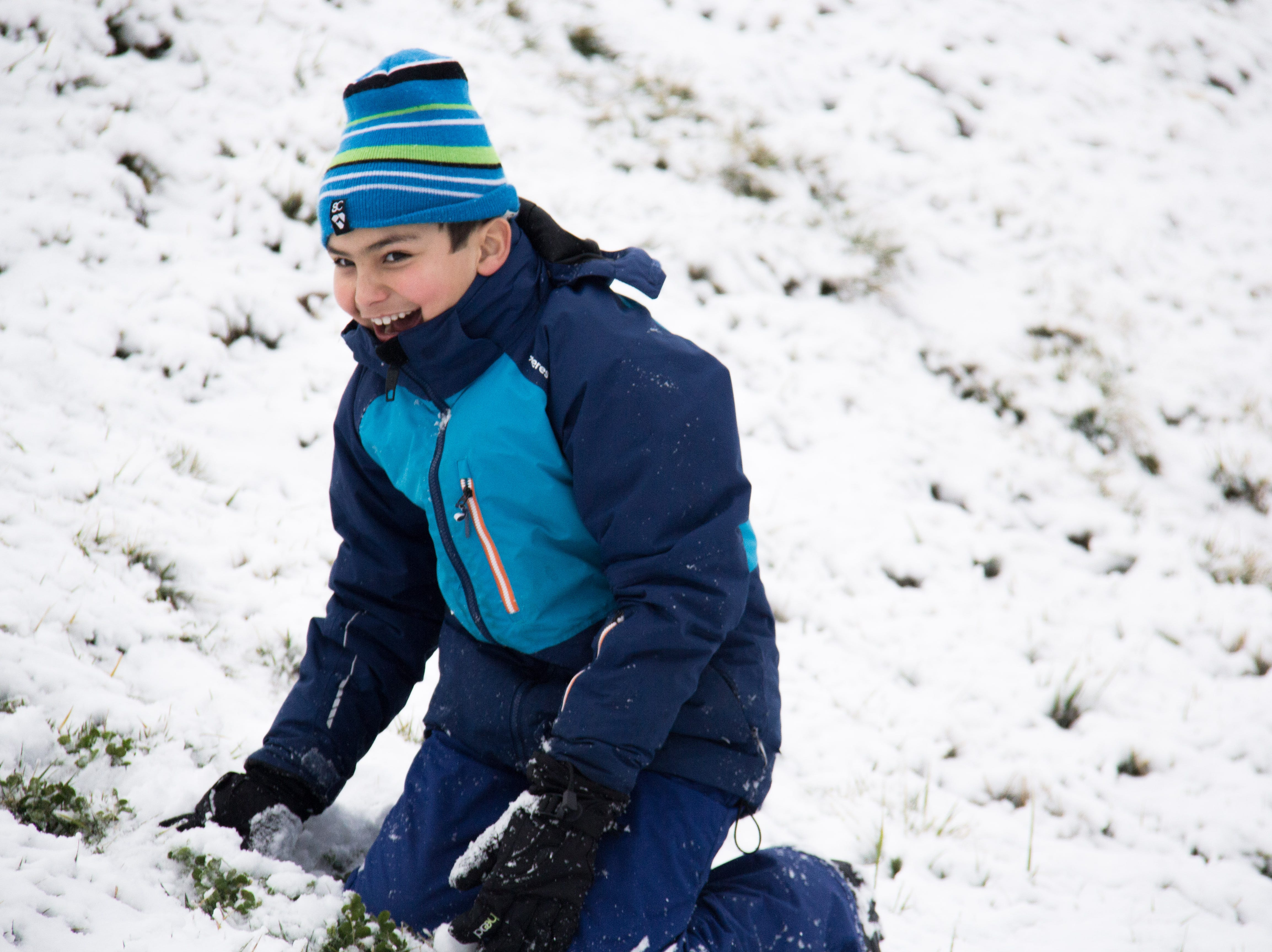 Nine-year-old Ian plays in the snow at Lakeshore Park in Knoxville on Jan. 29, 2019.