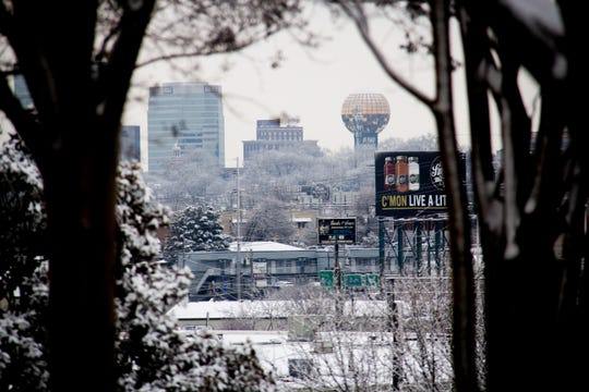 A view of downtown Knoxville from the News Sentinel shows the ground, buildings and trees dusted with snow on Jan. 29, 2019.