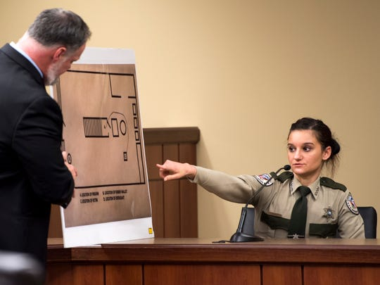 Campbell County Sheriff's Deputy Tosha Tackett, right, points out an area on a diagram held by Assistant District Attorney General David Pollard during Kenneth Bartley's trial at Campbell County Criminal Court in Jacksboro, Tenn., on Tuesday, January 29, 2019.