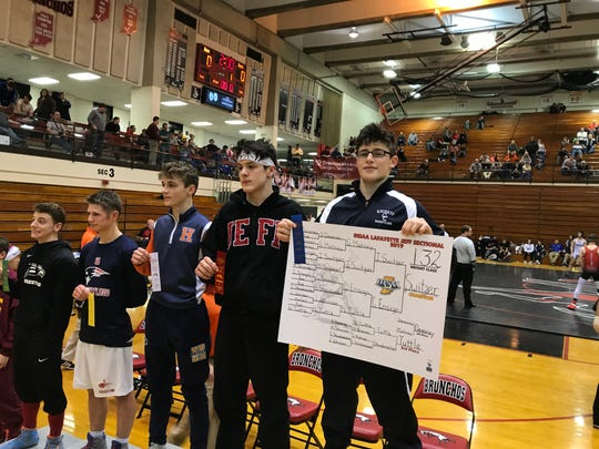 Central Catholic's Isaac Switzer won a sectional title at 132 pounds last Saturday.
