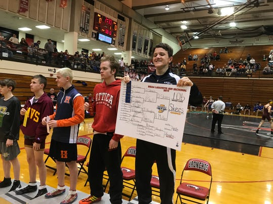 Dominic Skees opened up last Saturday's wrestling sectional by winning the 106-pound title to become Central Catholic's first champion in 20 years.