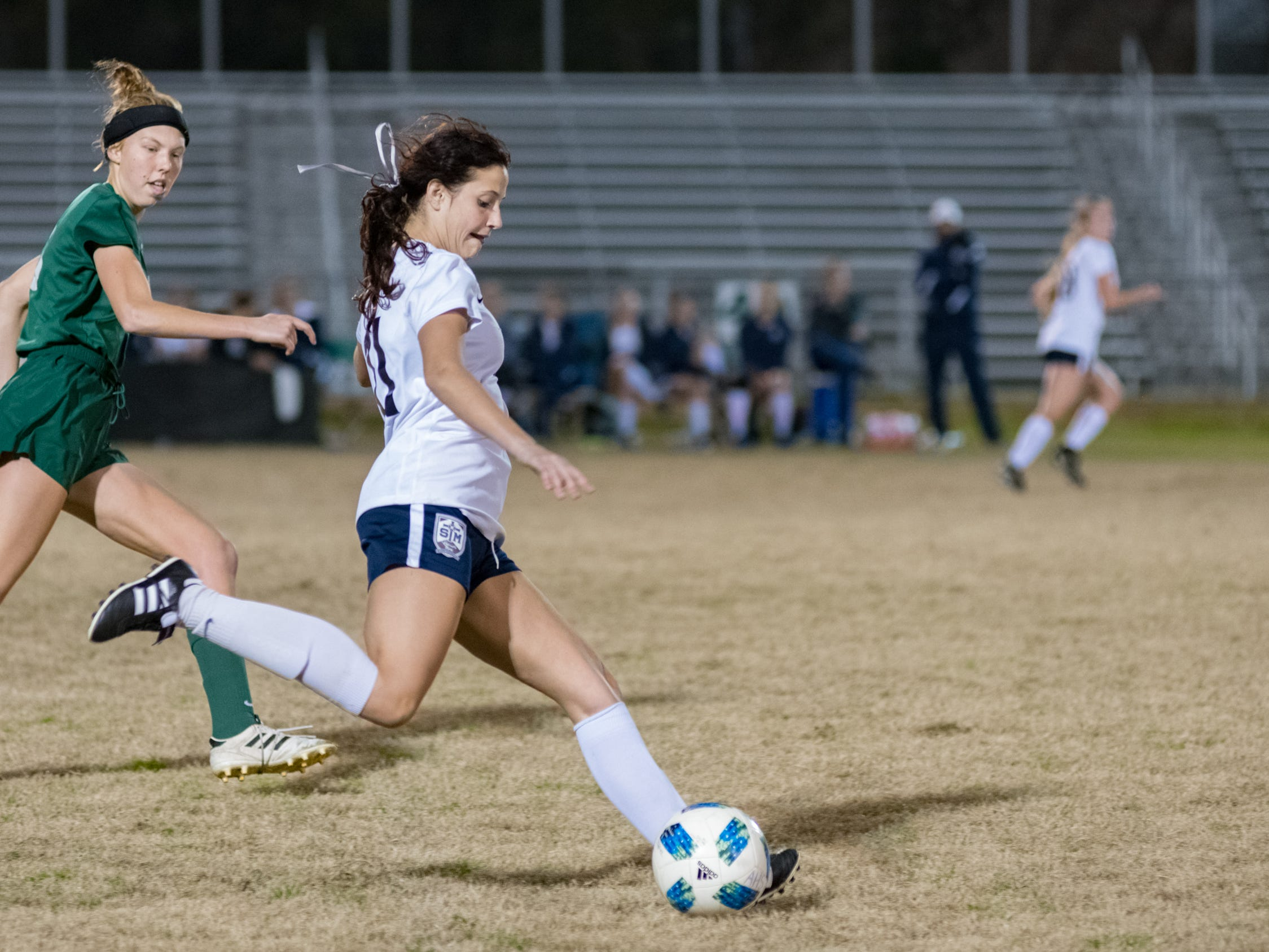 Emily Champion passes the ball as Acadiana takes on STM girls soccer. Monday, Jan. 28, 2019.