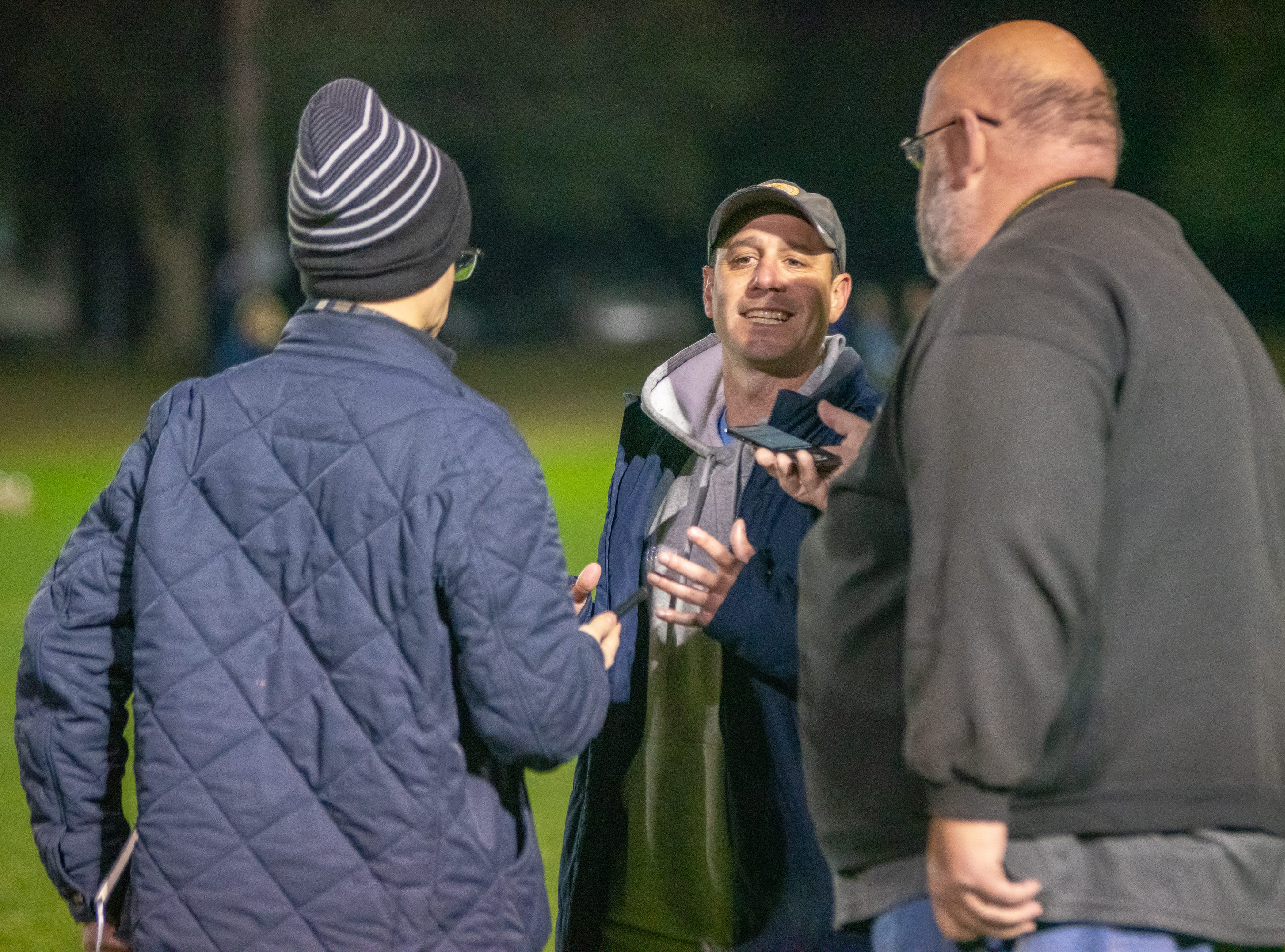 ESA's head coach J.B. Brunet talks with reporters after the game as the ESA Falcons take on the Catholic High Panthers on January 28, 2019.