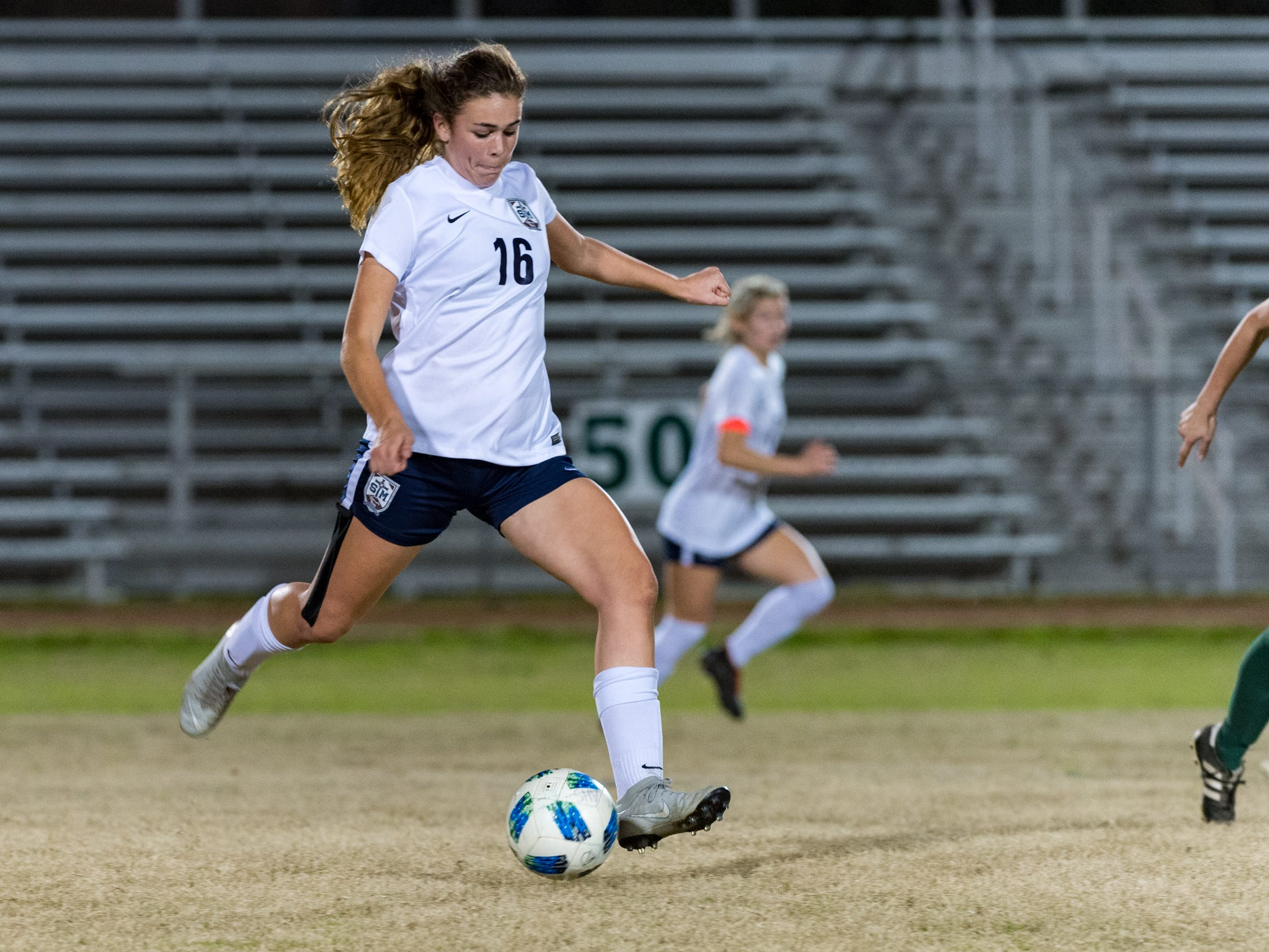 Hailey Gannon passes the ball as Acadiana takes on STM girls soccer. Monday, Jan. 28, 2019.