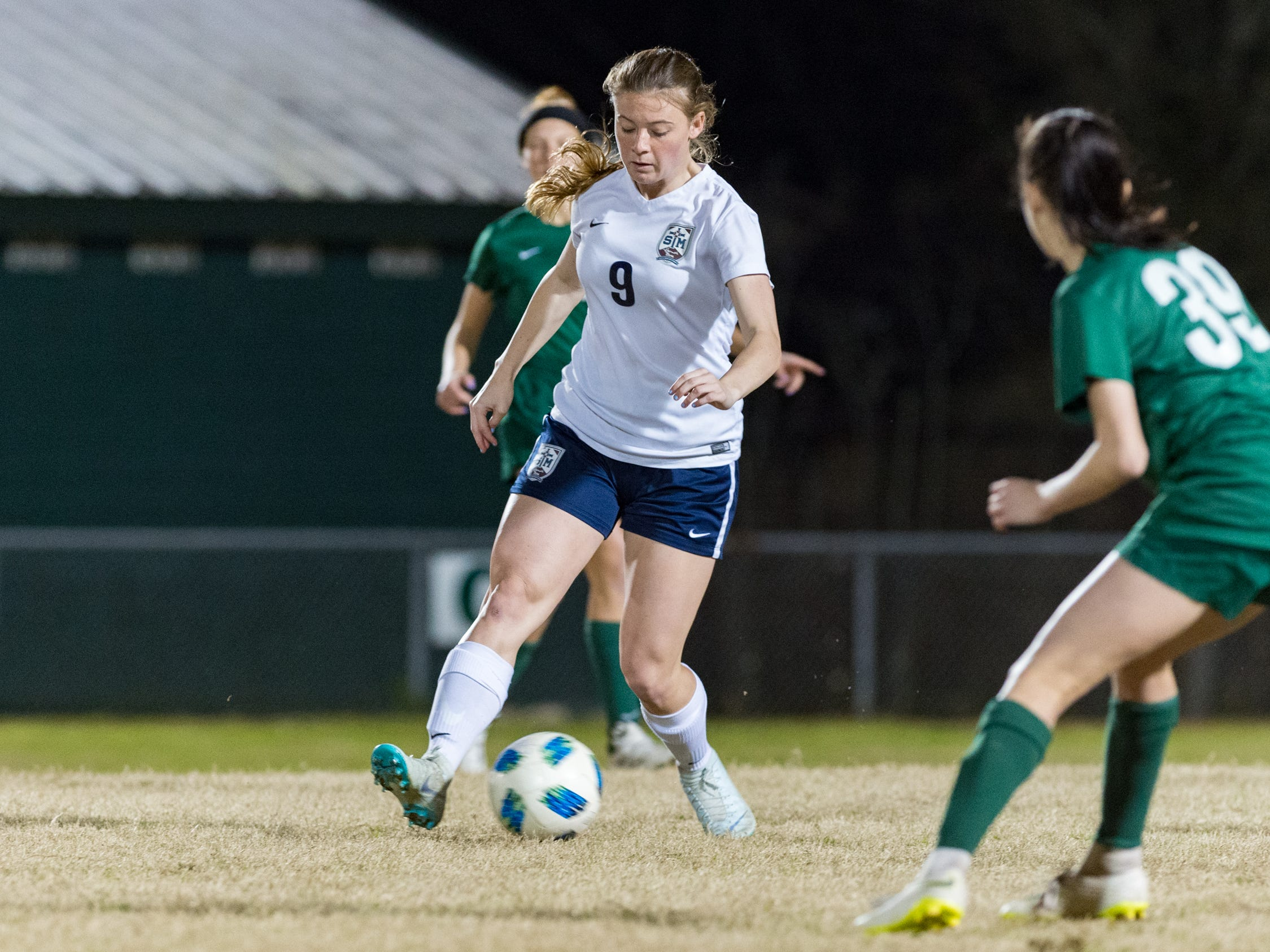 Peyton St. Pierre moves the ball as Acadiana takes on STM girls soccer. Monday, Jan. 28, 2019.