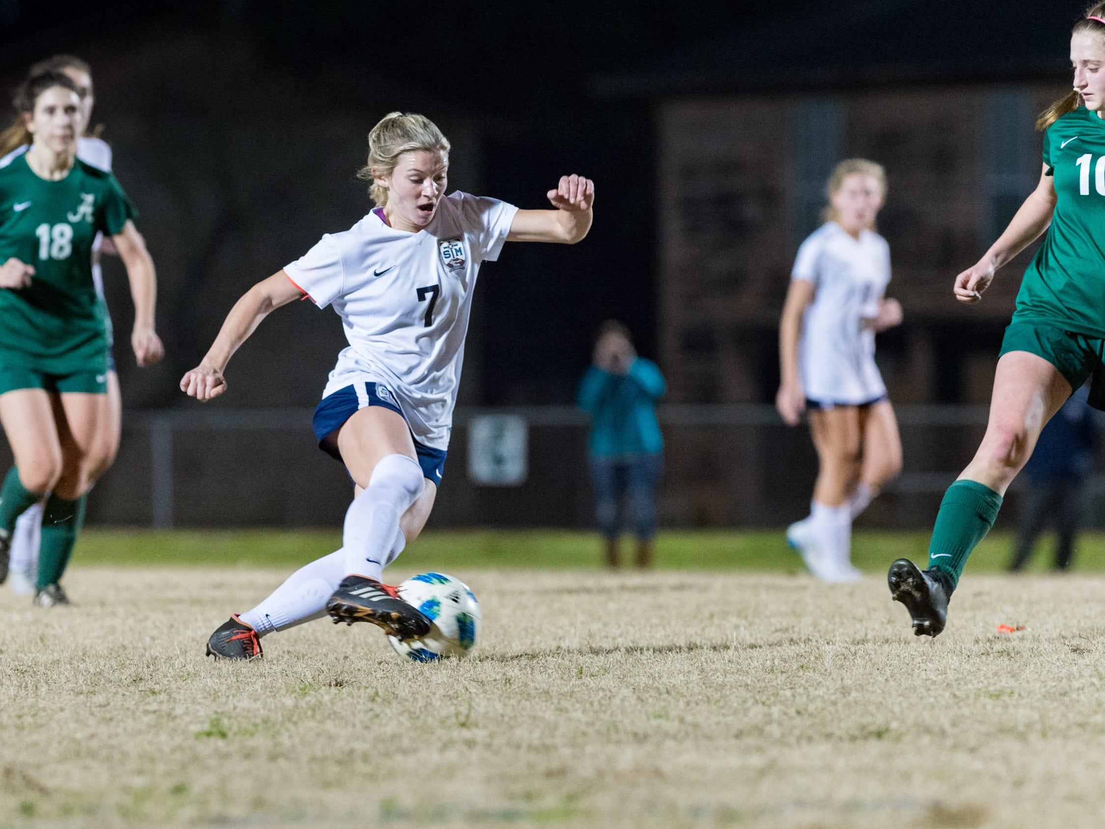 Maddie Moreau dribbles the ball as Acadiana takes on STM girls soccer. Monday, Jan. 28, 2019.