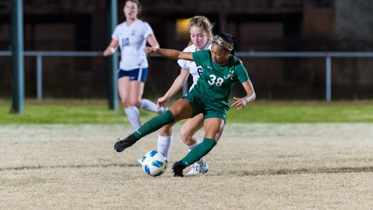 Acadiana High's Rammie Noel battles with St. Thomas More's Avery Quoyeser during the Lady Rams' 3-2 win over the Lady Cougars on Monday on Ted Davidson Field at Bill Dotson Stadium.