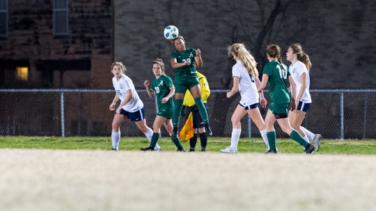 Acadiana's Rammie Noel delivers a header during the Lady Rams' 3-2 win over St. Thomas More on Monday on Ted Davidson Field at Bill Dotson Stadium.