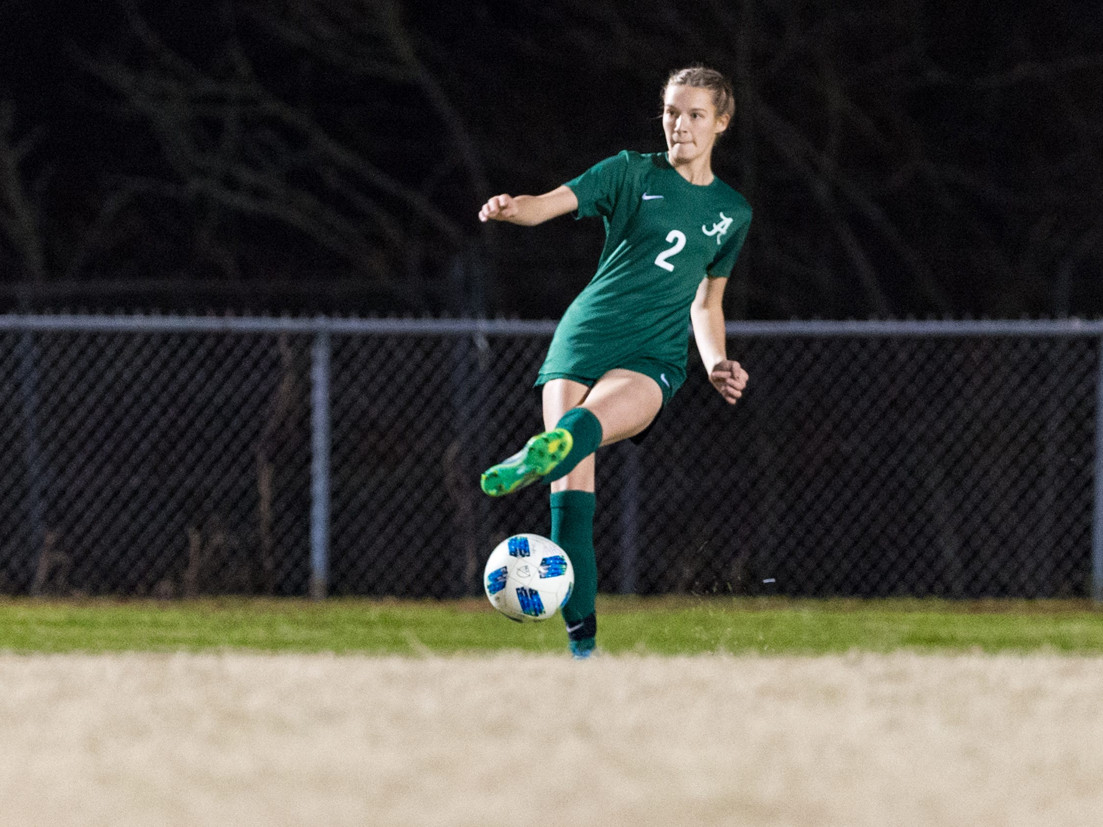 Kati Gillen passes the ball as Acadiana takes on STM girls soccer. Monday, Jan. 28, 2019.