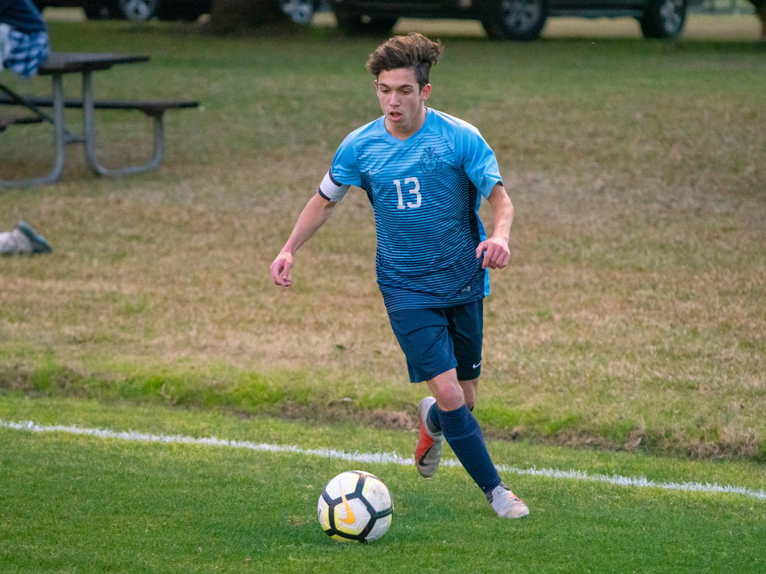 ESA's Nathan Mouton moves the ball down the field as the ESA Falcons take on the Catholic High Panthers on January 28, 2019.