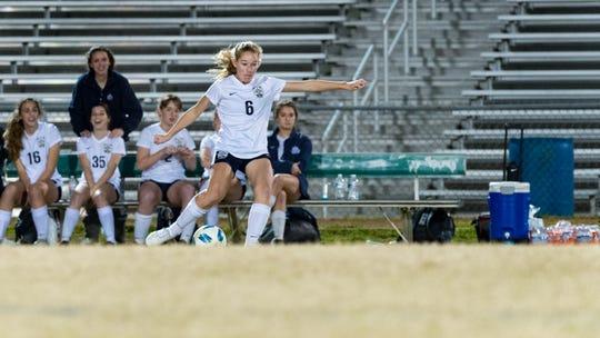 Avery Quoyeser moves the ball as Acadiana takes on STM girls soccer. Monday, Jan. 28, 2019.