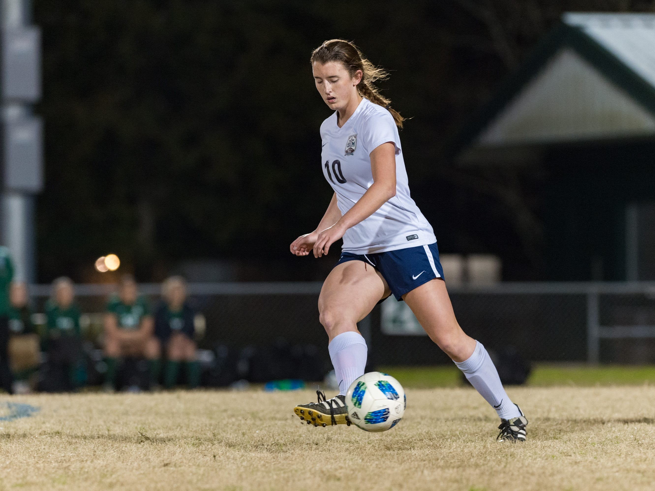 Claire Werther passes the ball as Acadiana takes on STM girls soccer. Monday, Jan. 28, 2019.
