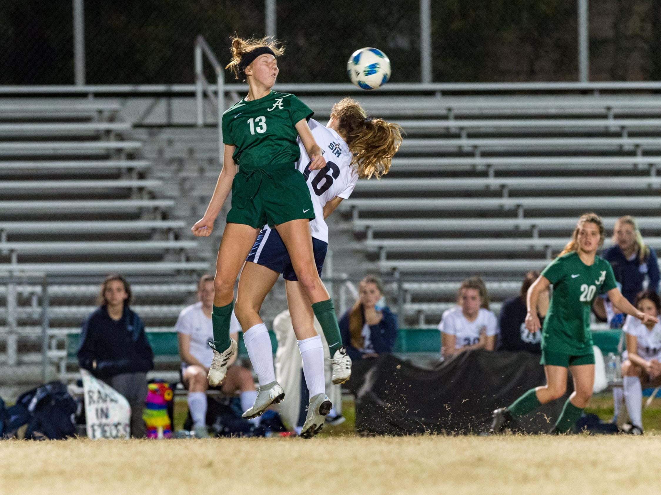 Emma Young header as Acadiana takes on STM girls soccer. Monday, Jan. 28, 2019.