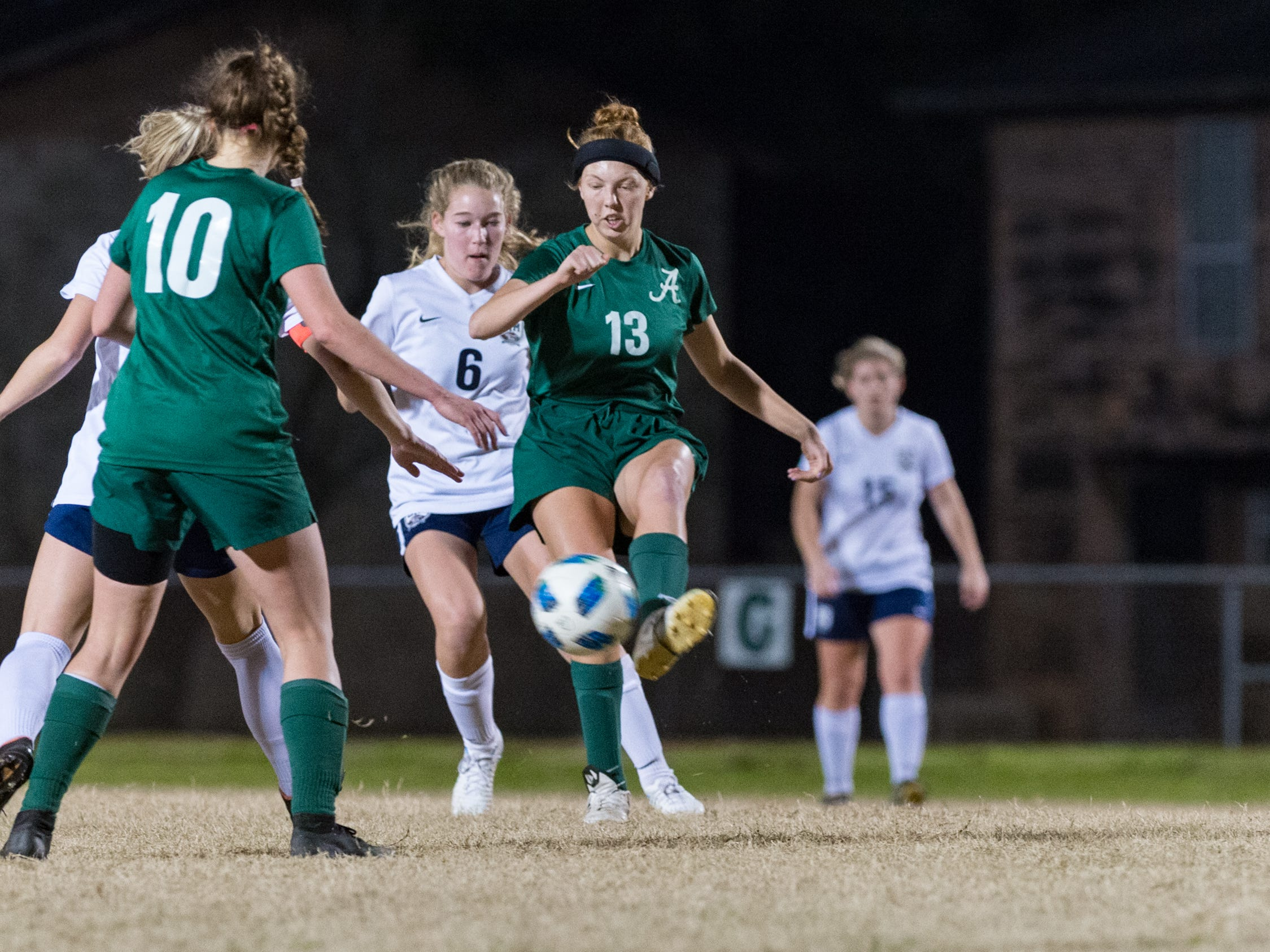 Emma Young passes the ball as Acadiana takes on STM girls soccer. Monday, Jan. 28, 2019.