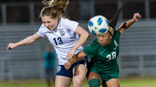 Rammie Noel battles with Riley Leblanc for the ball as Acadiana takes on STM girls soccer. Monday, Jan. 28, 2019.