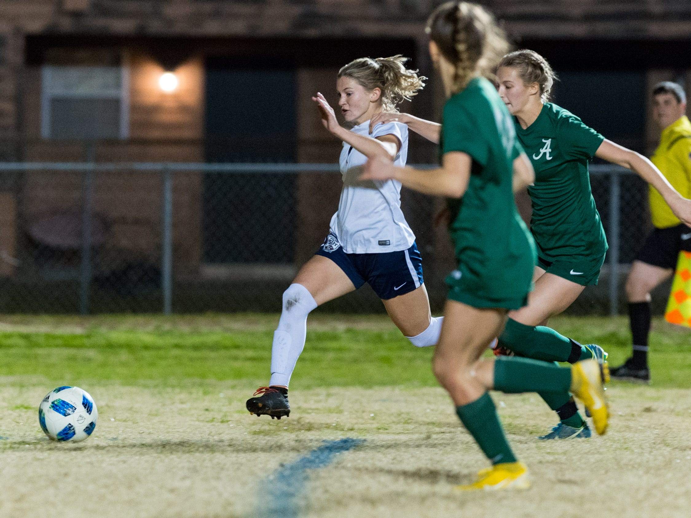 Maddie Moreau drives the ball to the goal as Acadiana takes on STM girls soccer. Monday, Jan. 28, 2019.