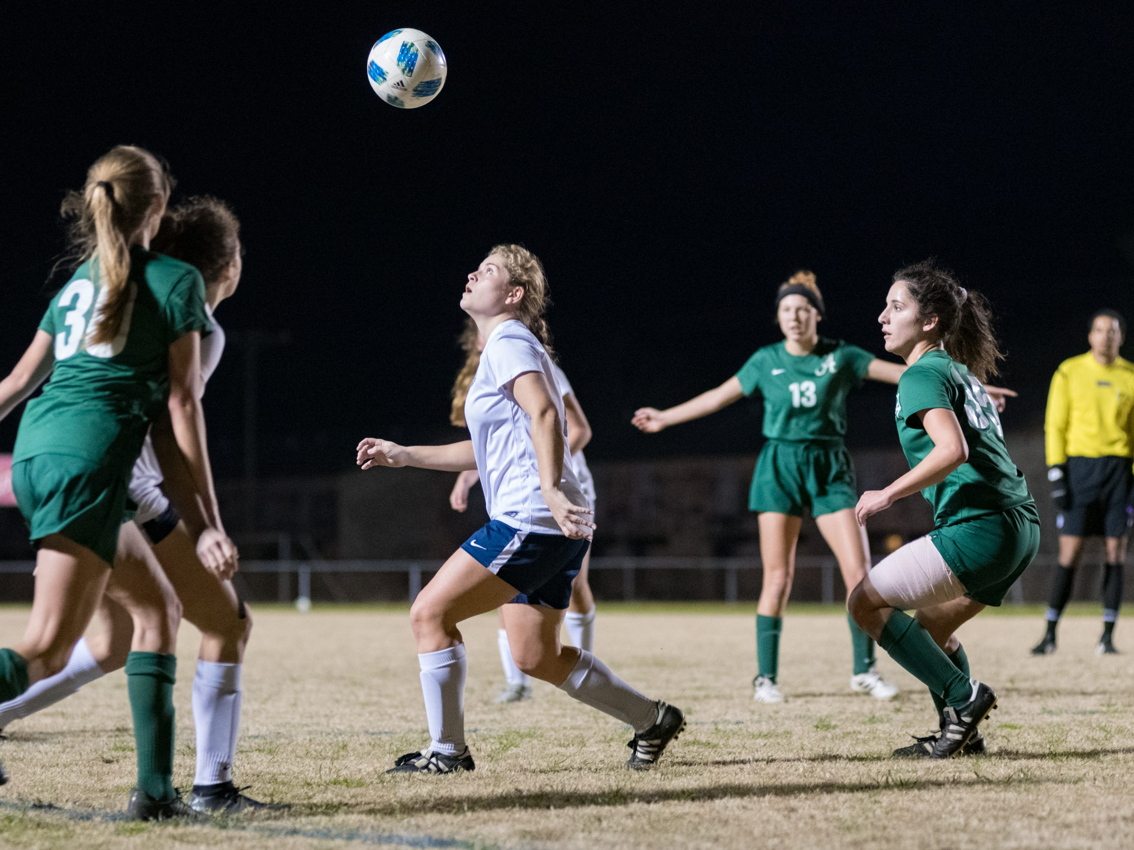 Amelie Echeverria header as Acadiana takes on STM girls soccer. Monday, Jan. 28, 2019.