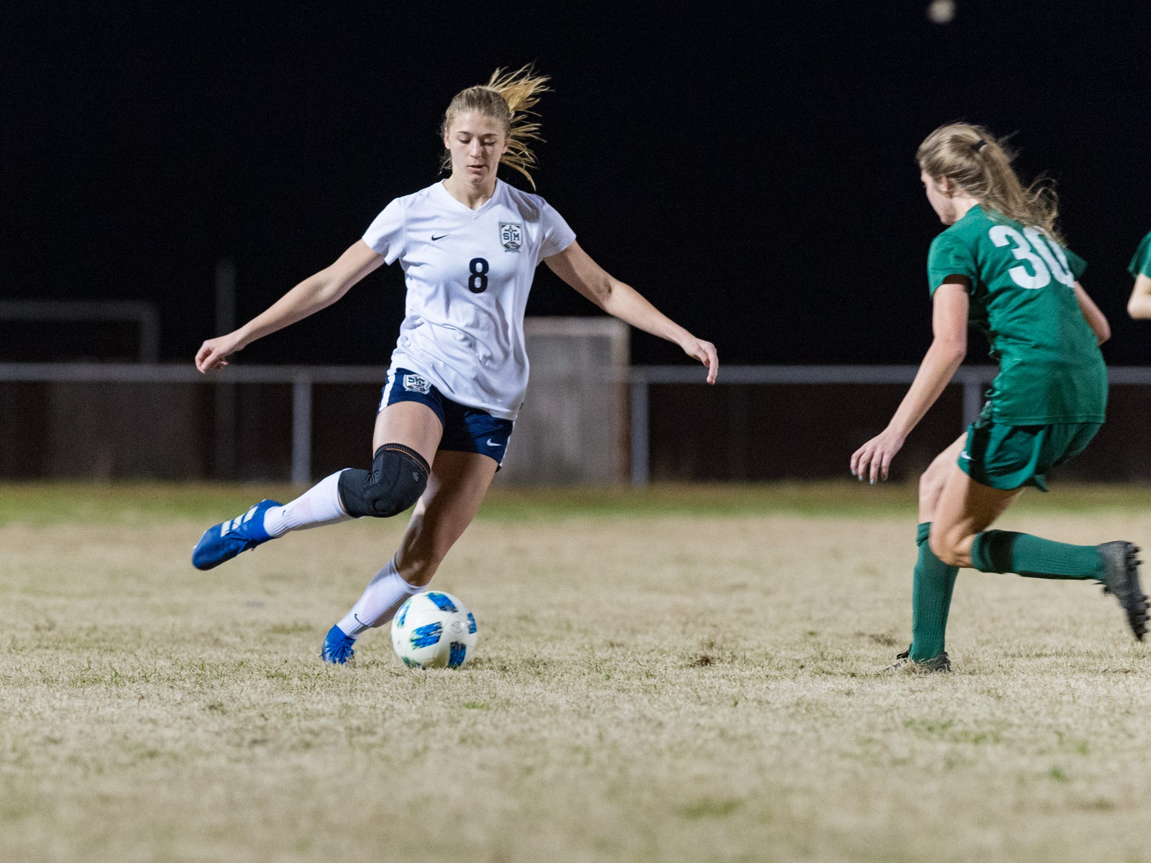 Julia Spielmann passes the ball as Acadiana takes on STM girls soccer. Monday, Jan. 28, 2019.