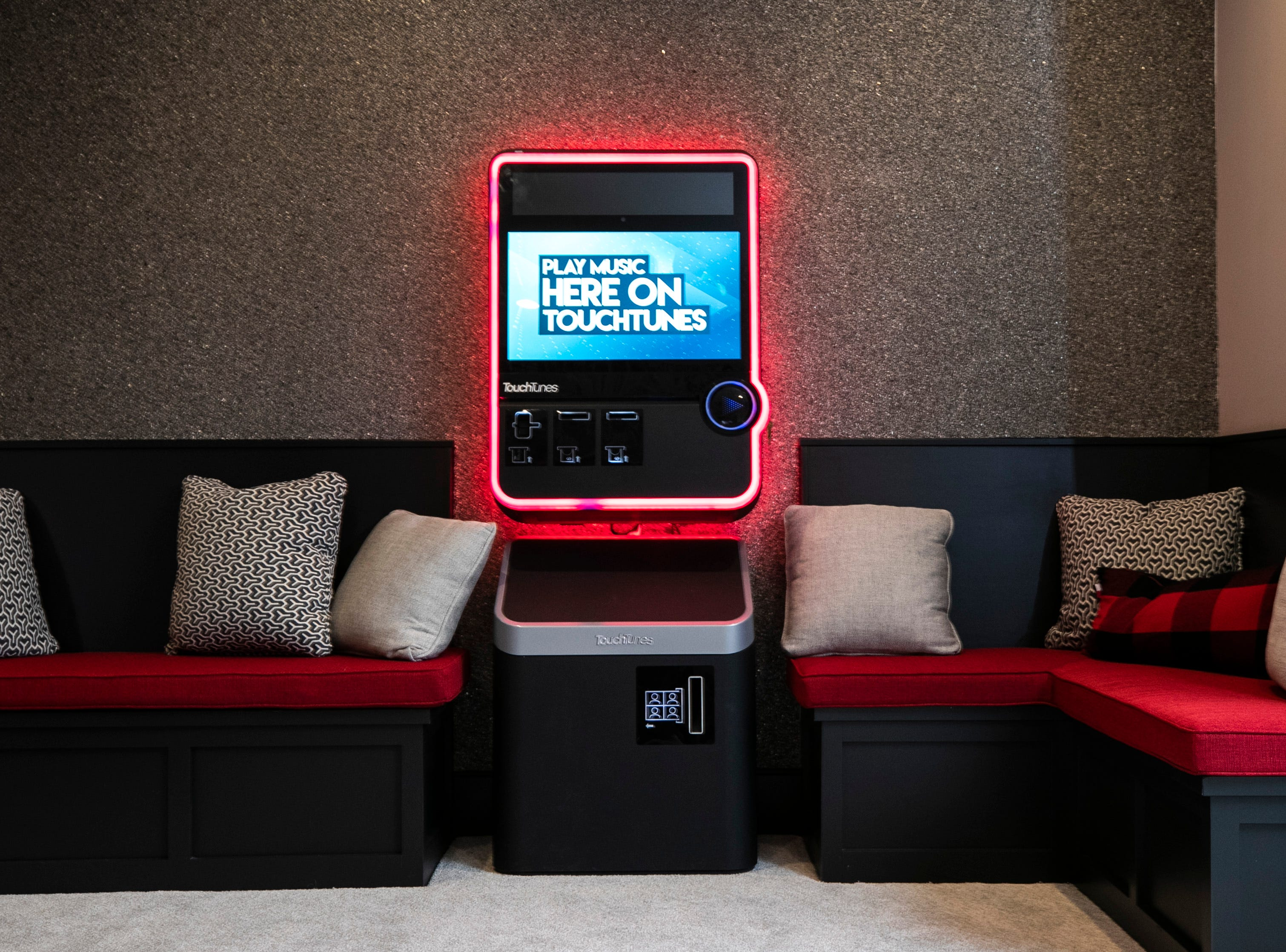 The basement of the Mack home features a digital jukebox.