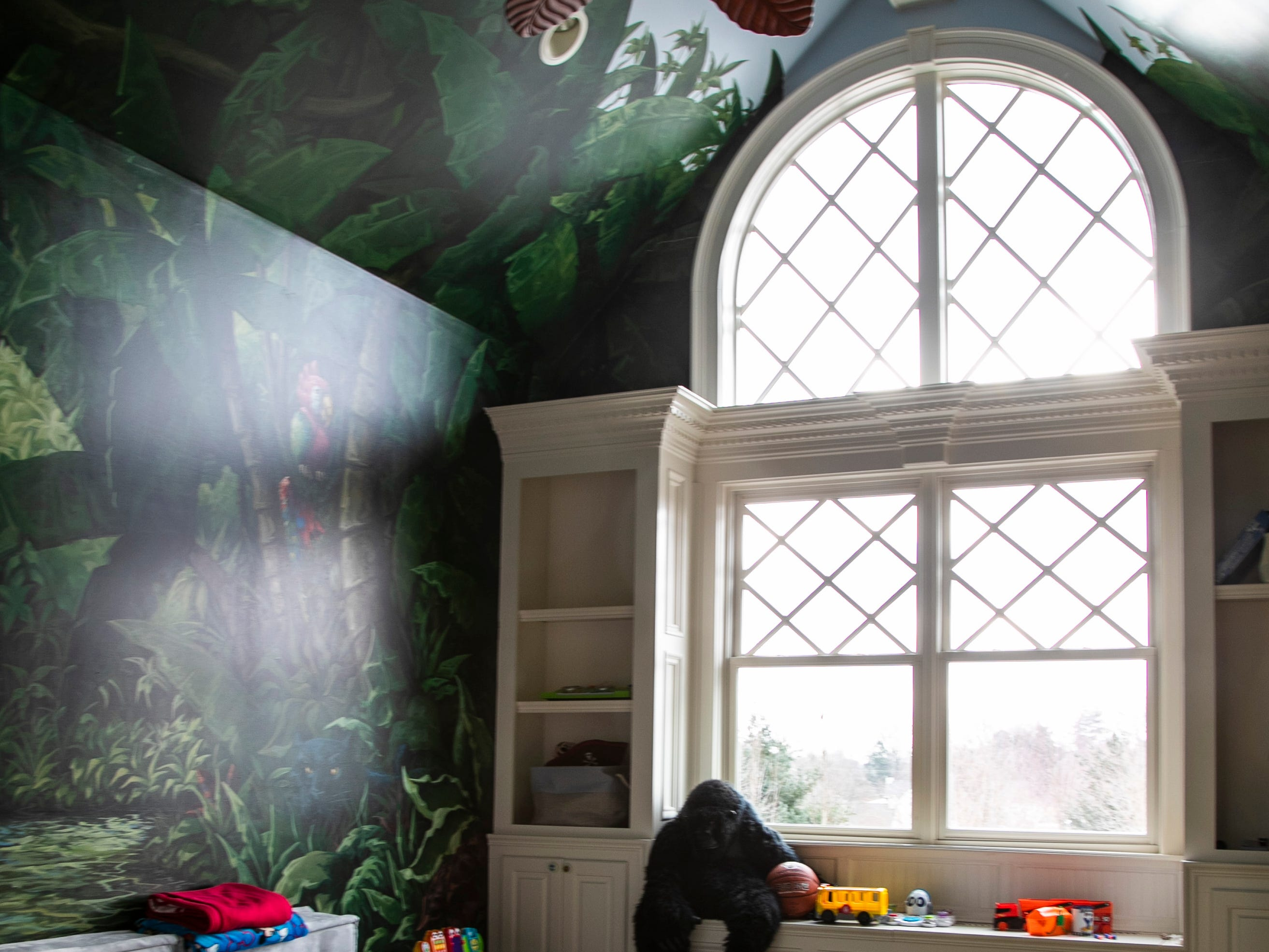 Brayden Mack's room has a jungle theme, from, his bedroom to a playroom with a red Louisville shower curtain and red sink.