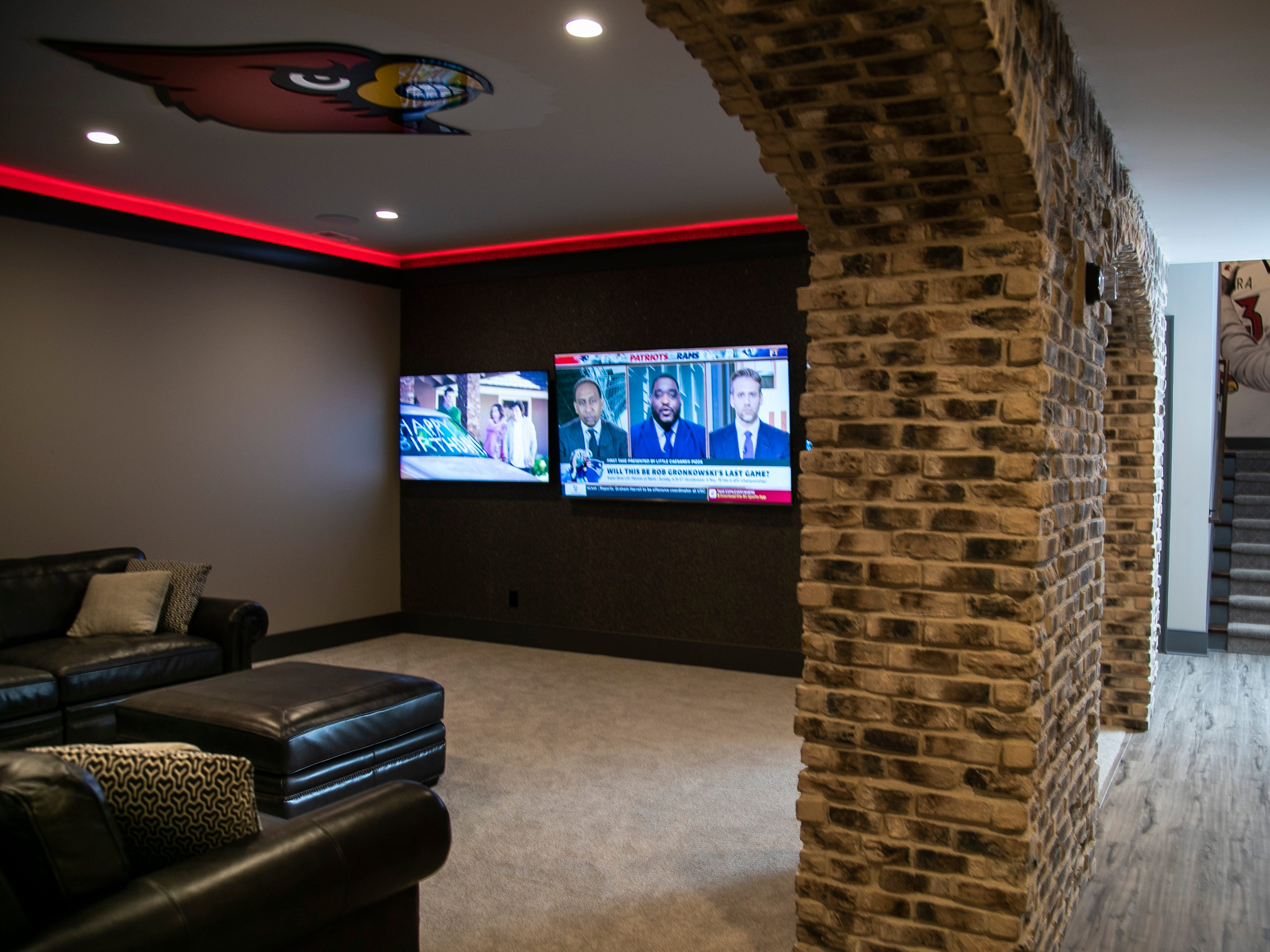 The basement of the Mack home features video games and plenty of flatscreen tvs that are often tuned to ESPN. There's also personal memorabilia such as a signed Red photo by Pete Rose, and Christi Mack's Hall of Fame jersey.