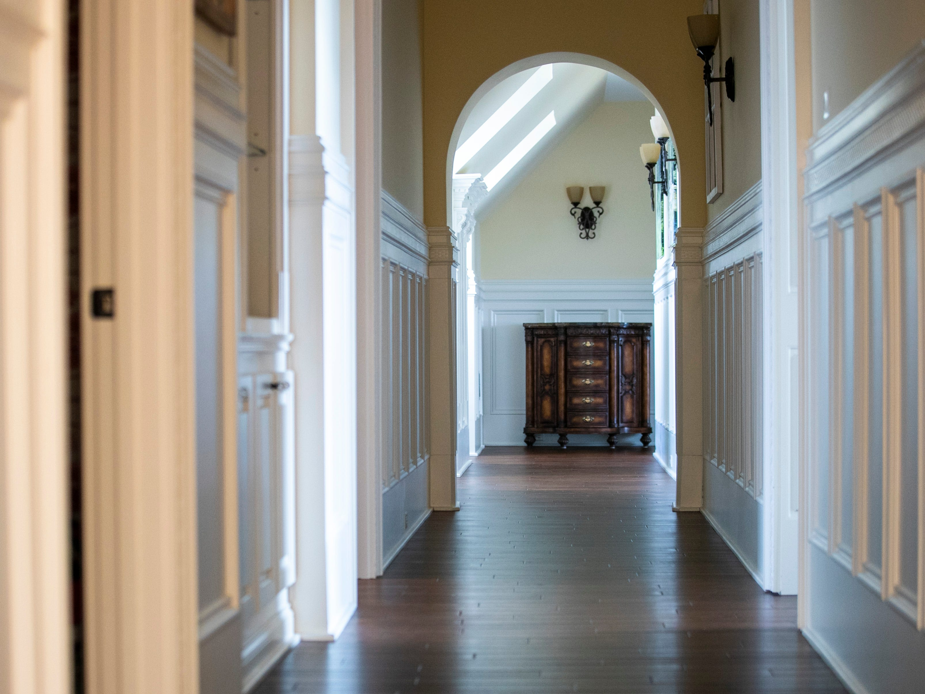 The second floor of the Mack home features a long hallway that connects to a large rec room.