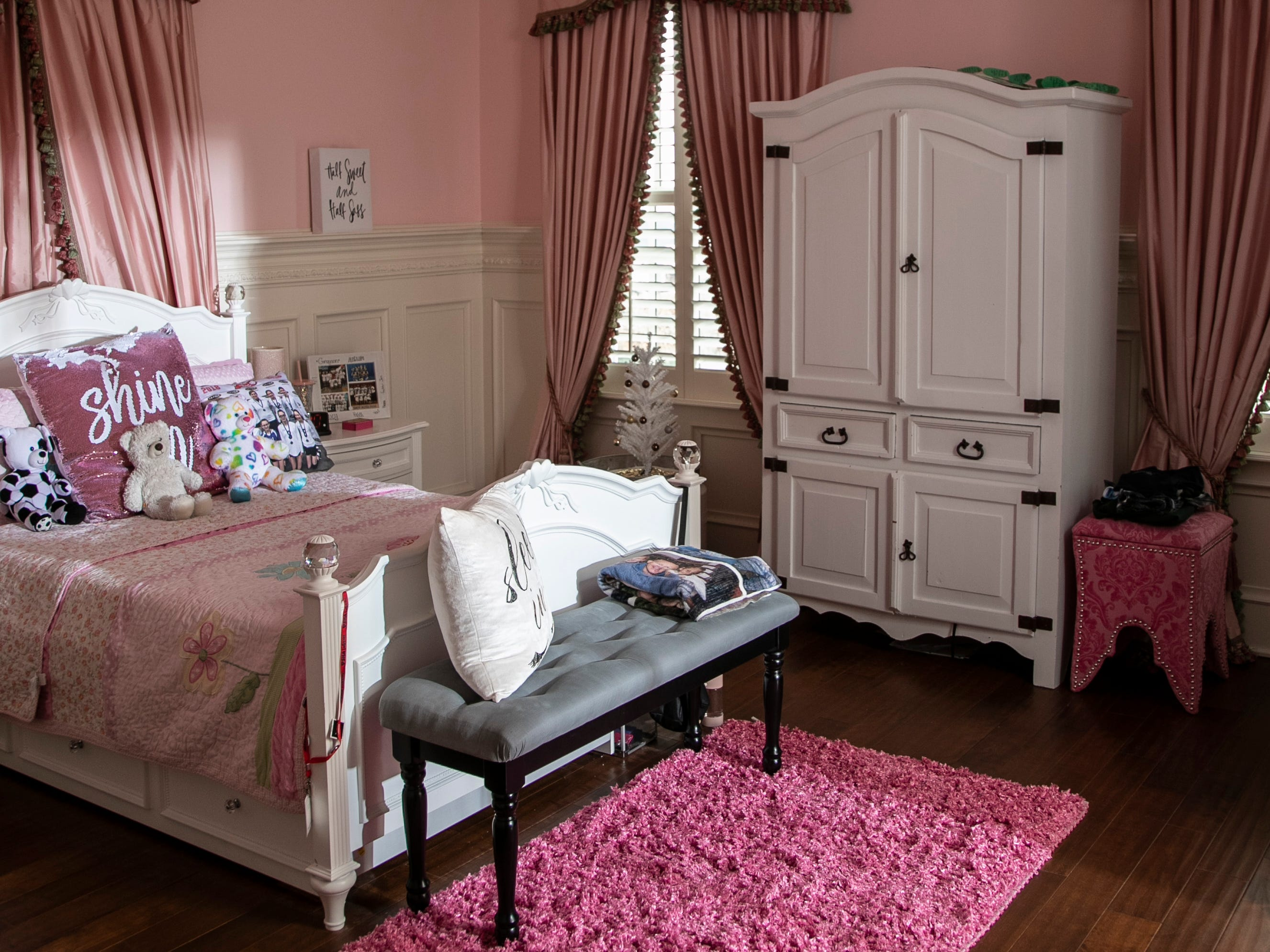 The bedroom for Hailee Mack has pink walls.