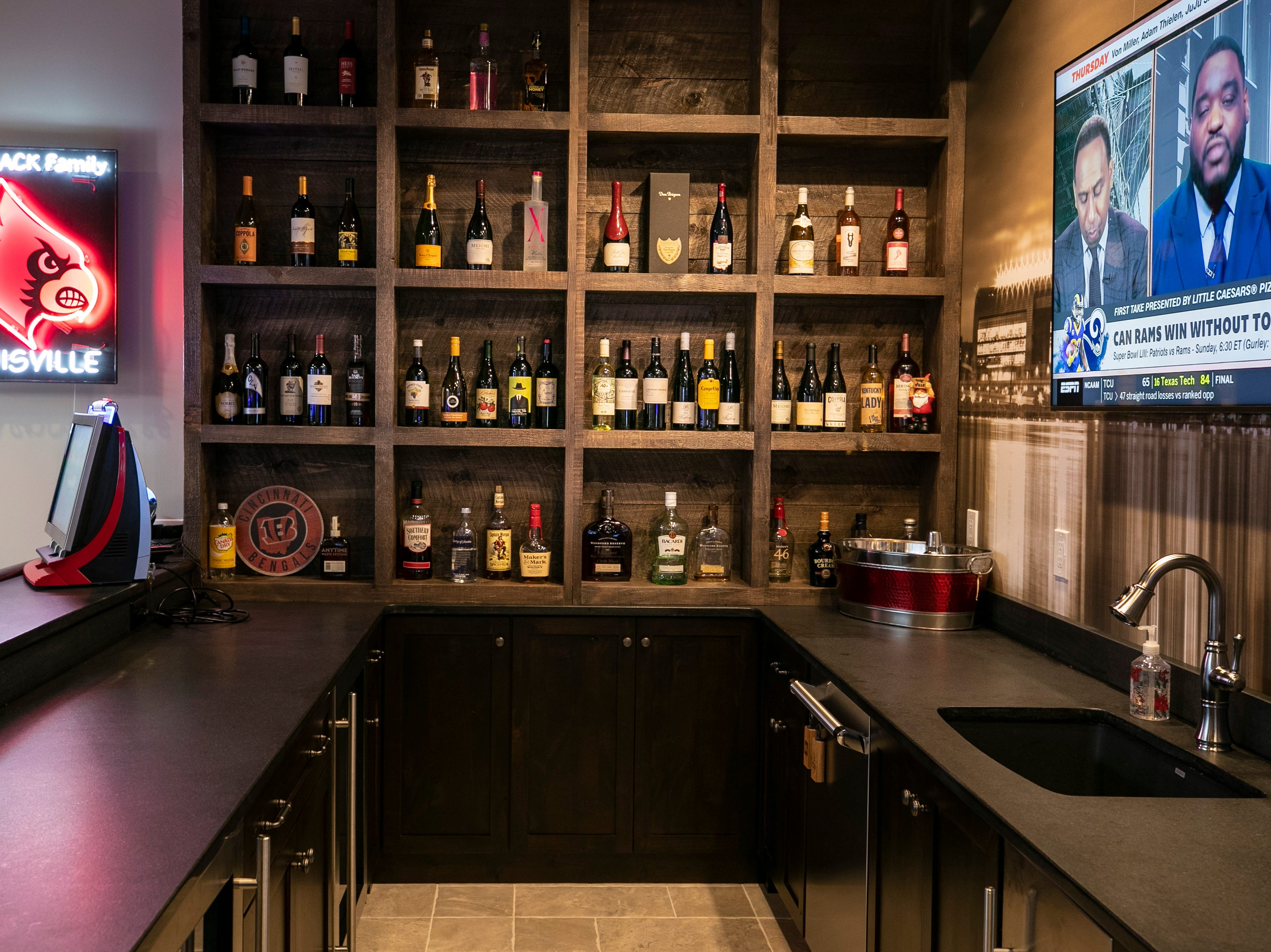 The basement of the Mack home features a bar with plenty of choices from bourbon to wine as well as plenty of seats.