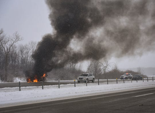 A sedan is ablaze on Interstate-96 east bound near the US-127 interchange, Tuesday morning, Jan. 29, 2019.  Ingham County Sheriff and Meridian Township Fire are on scene.