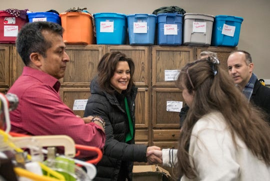Michigan Governor Gretchen Whitmer meets Stephanie Barnhart of Cristo Rey Community Center in Lansing Tuesday, Jan. 29, 2019.  Also pictured are (from l.) Joe Garcia, executive director of Cristo Rey, and Lansing Mayor Andy Schor.  [AP Photo/Matthew Dae Smith/Lansing State Journal]