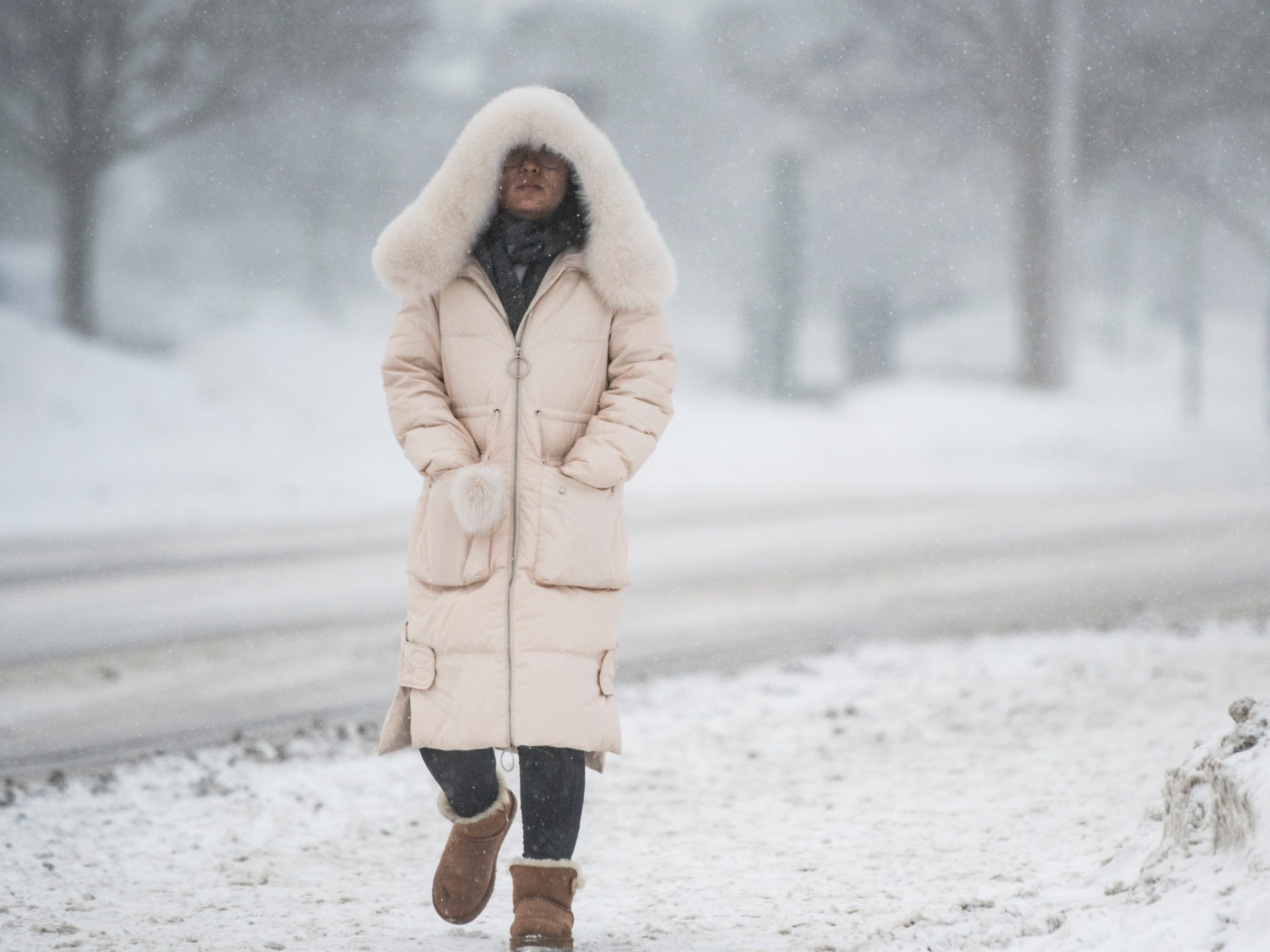 A woman heads across the campus of Michigan State University Tuesday, Jan. 29, 2019, in East Lansing, Michigan.  MSU has called off classes tommorow due to bitter temperatures.  [USA Today Network/Matthew Dae Smith/Lansing State Journal]
