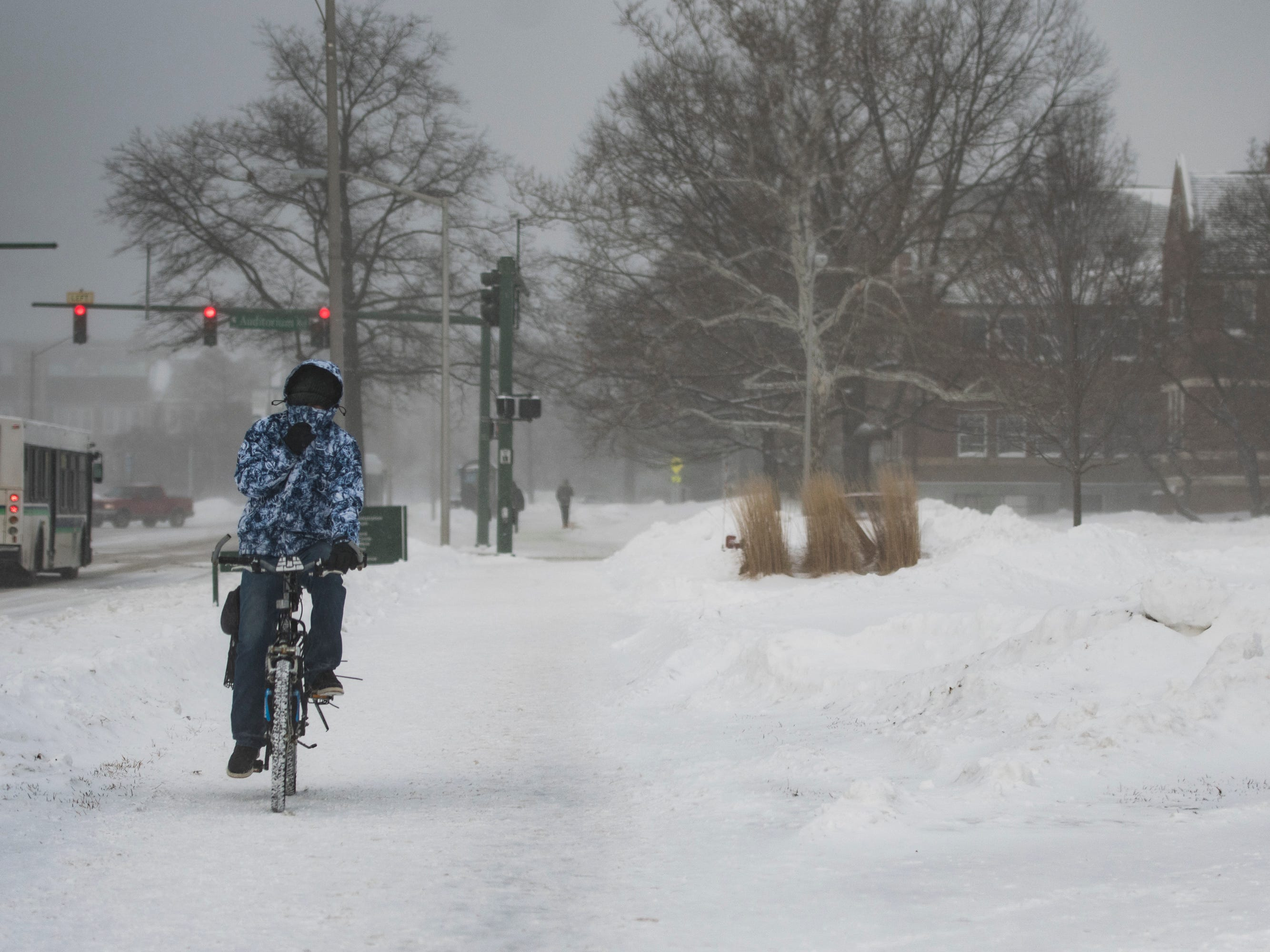 Despite sub-zero windchills, a bicyclist makes his way across campus on the campus of Michigan State University Tuesday, Jan. 29, 2019, in East Lansing, Michigan.  MSU has called off classes tommorow due to bitter temperatures.  [USA Today Network/Matthew Dae Smith/Lansing State Journal]