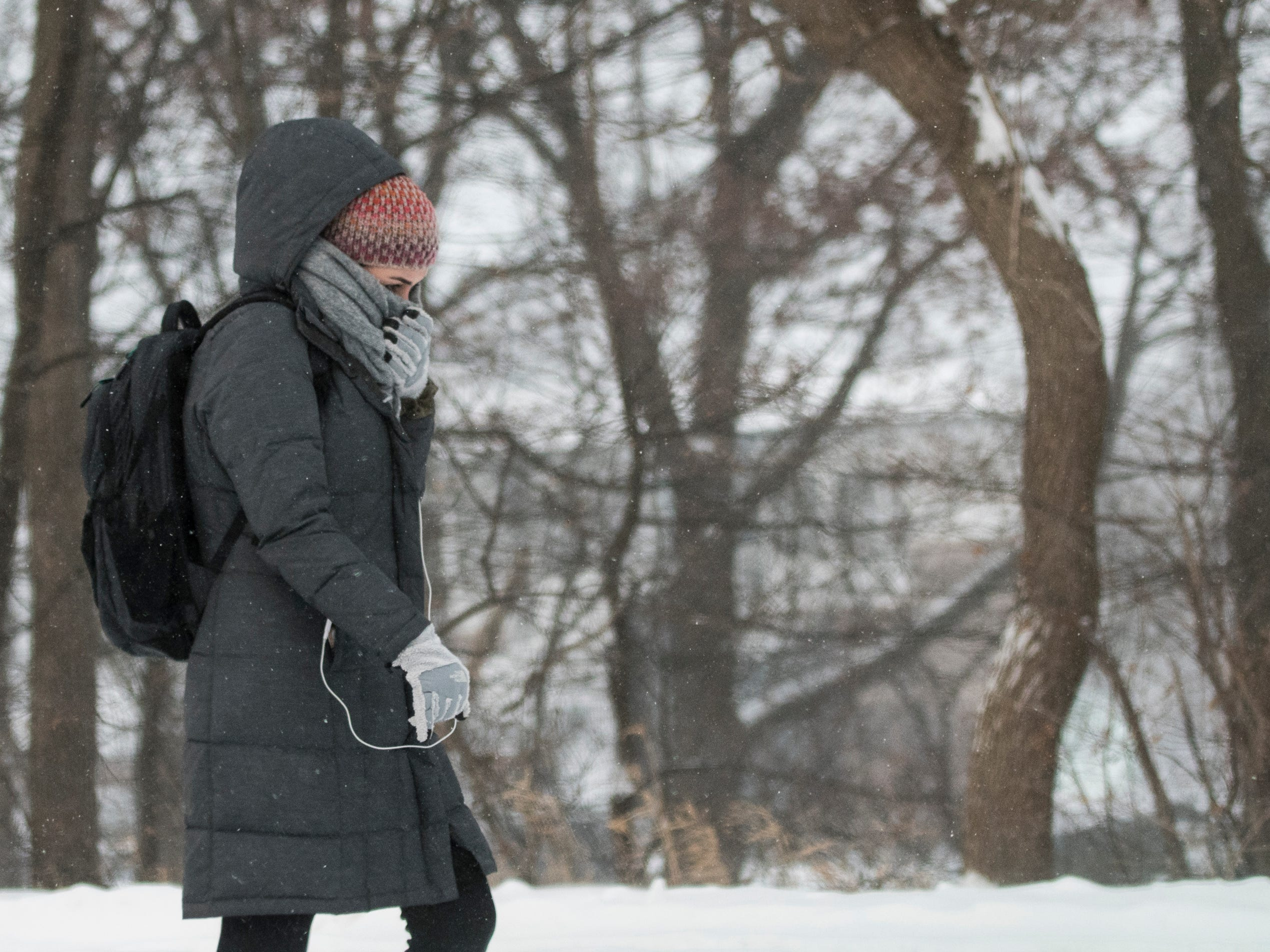A woman walks on the campus of Michigan State University Tuesday, Jan. 29, 2019, in East Lansing, Michigan.  MSU has called off classes tommorow due to bitter temperatures.  [USA Today Network/Matthew Dae Smith/Lansing State Journal]