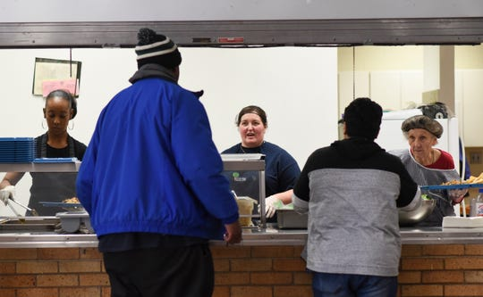 People are served lunch Tuesday, Jan. 29, 2019, at Cristo Rey Community Center in Lansing. The community center serves breakfast and lunch Monday through Friday, about 100 meals per day.