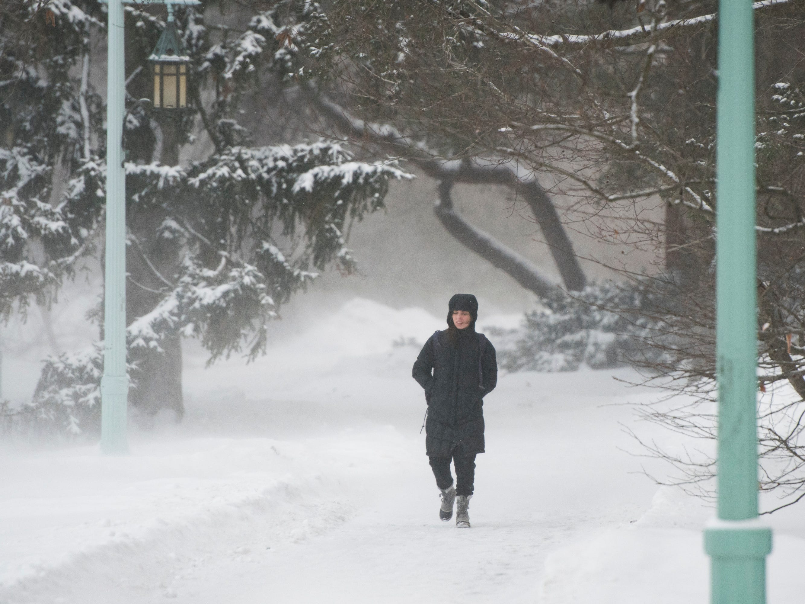 Despite sub-zero windchills, a woman makes her way across campus on the campus of Michigan State University Tuesday, Jan. 29, 2019, in East Lansing, Michigan.  MSU has called off classes tommorow due to bitter temperatures.  [USA Today Network/Matthew Dae Smith/Lansing State Journal]