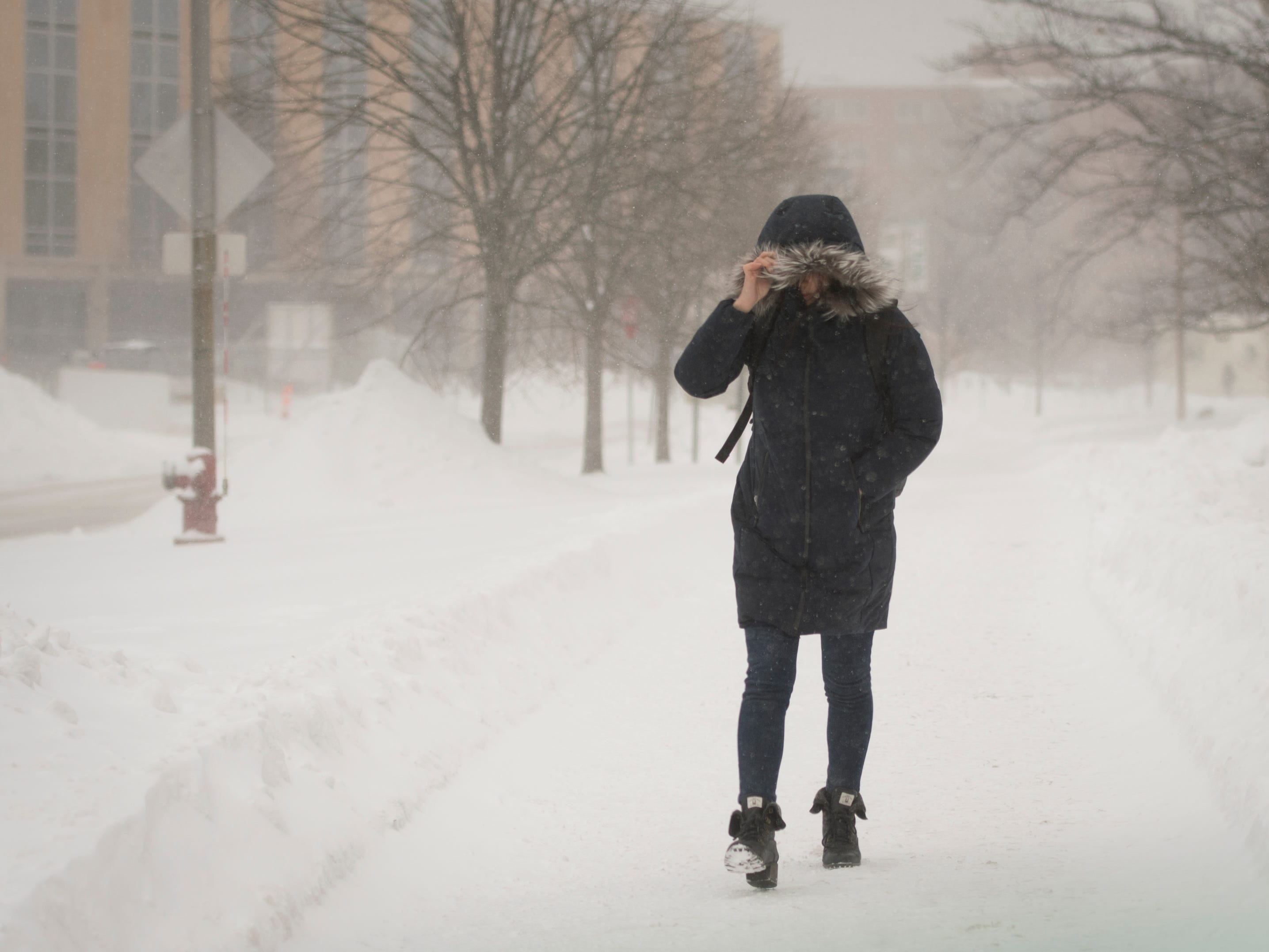 Despite sub-zero windchills, people walk on the campus of Michigan State University Tuesday, Jan. 29, 2019, in East Lansing, Michigan.  MSU has called off classes tommorow due to bitter temperatures.  [USA Today Network/Matthew Dae Smith/Lansing State Journal]