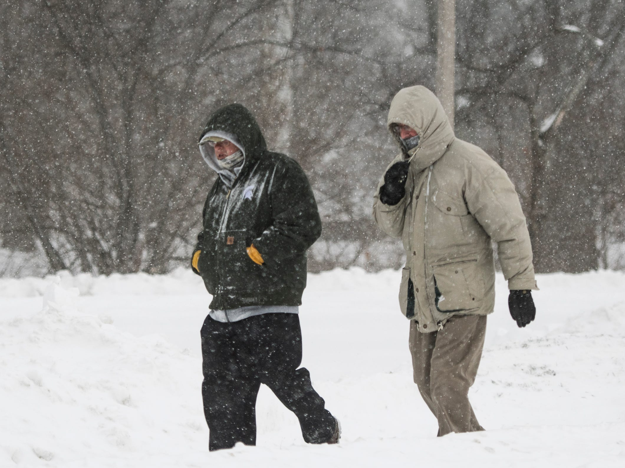 Two men walk on the campus of Michigan State University Tuesday, Jan. 29, 2019, in East Lansing, Michigan.  MSU has called off classes tommorow due to bitter temperatures.  [USA Today Network/Matthew Dae Smith/Lansing State Journal]