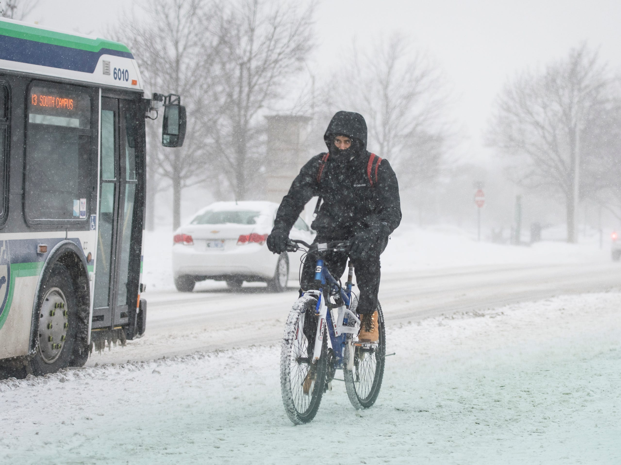 A bicyclist rides on the campus of Michigan State University Tuesday, Jan. 29, 2019, in East Lansing, Michigan.  MSU has called off classes tommorow due to bitter temperatures.  [USA Today Network/Matthew Dae Smith/Lansing State Journal]