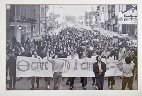 Sherrod Brown (center, back turned to camera) leads the first Earth Day rally in downtown Mansfield in 1970. Photo submitted by Paul McClain