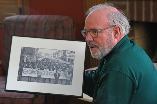 Paul McClain talks about his longtime friendship with Sherrod Brown. Both of the men are pictured in a 1970 photo from when the two organized a rally in Mansfield on the first year celebrating Earth Day.